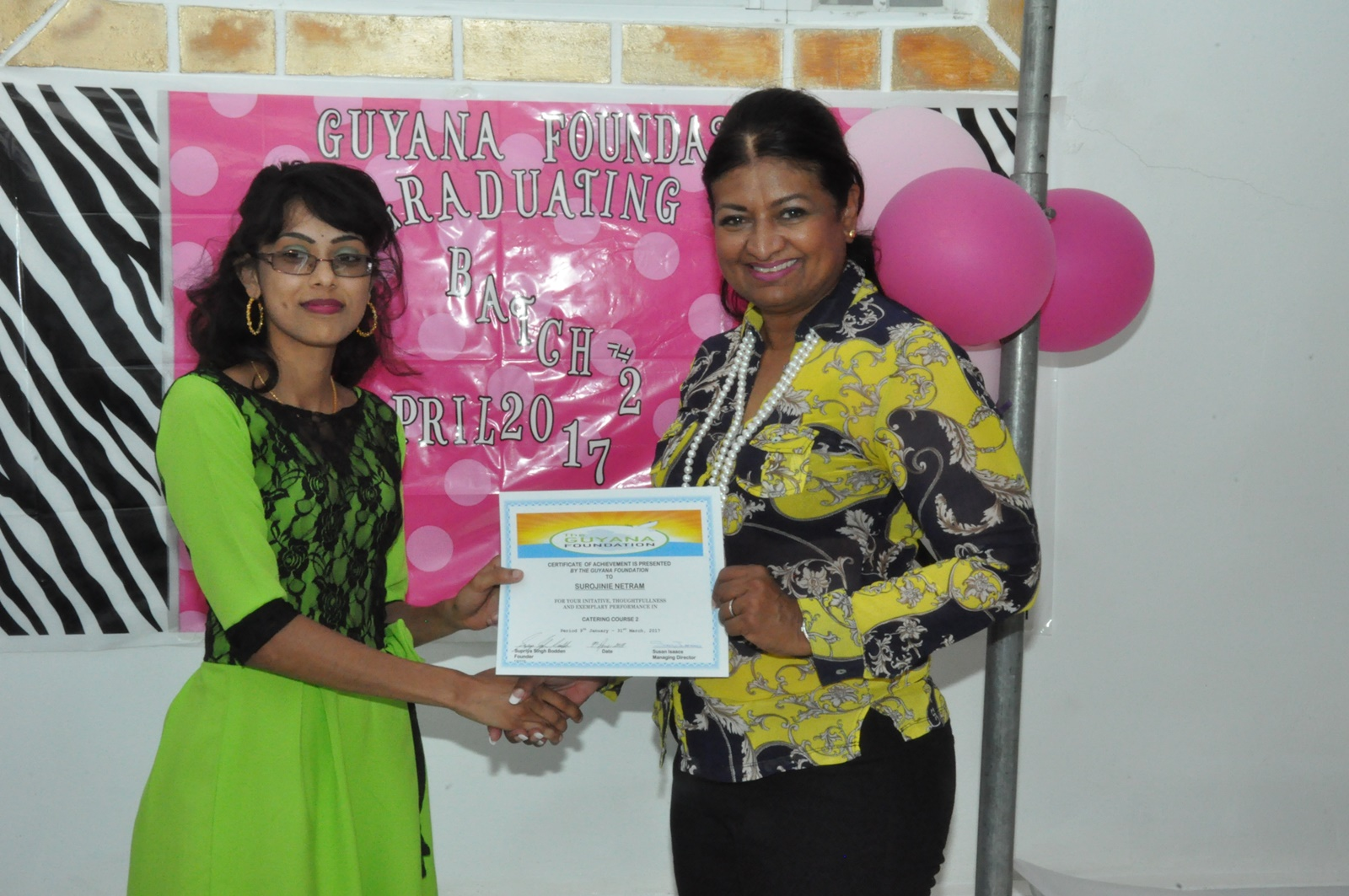 Founder, Mrs. Supriya Singh-Bodden presenting a certificate to a student from the Catering Class.