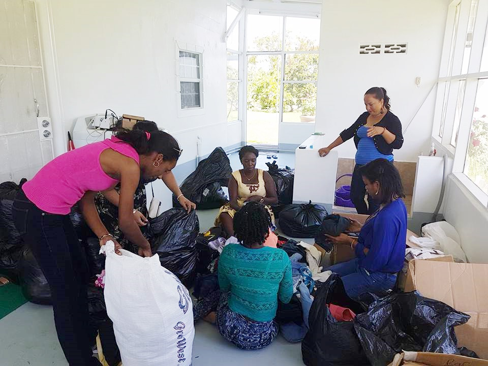 Volunteers sorting and packing clothing to be sent into Region No. 8 as well as to other regions in need.