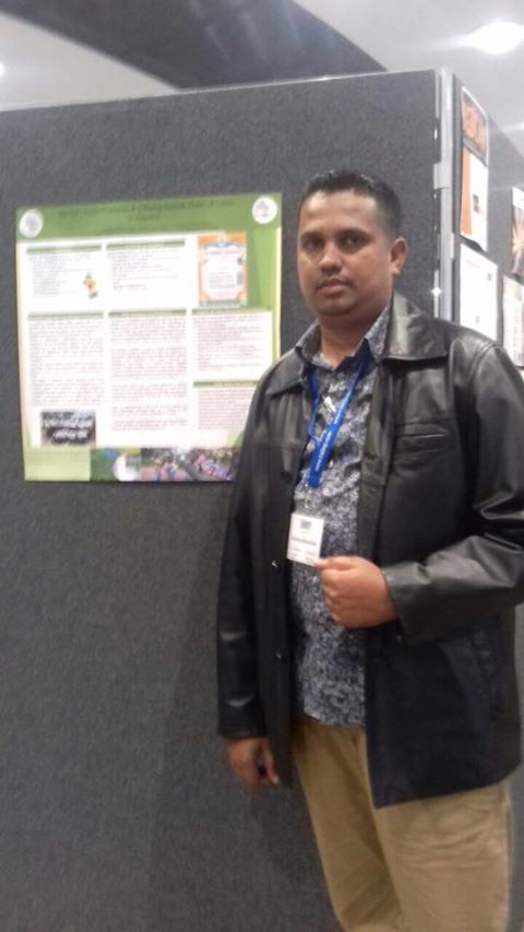 Haimraj Hamandeo, senior counselor of the Sunrise Center in session at the BABCP U.K. Conference on mental health. He is seen here standing in front of the poster board on the Guyana Foundation.