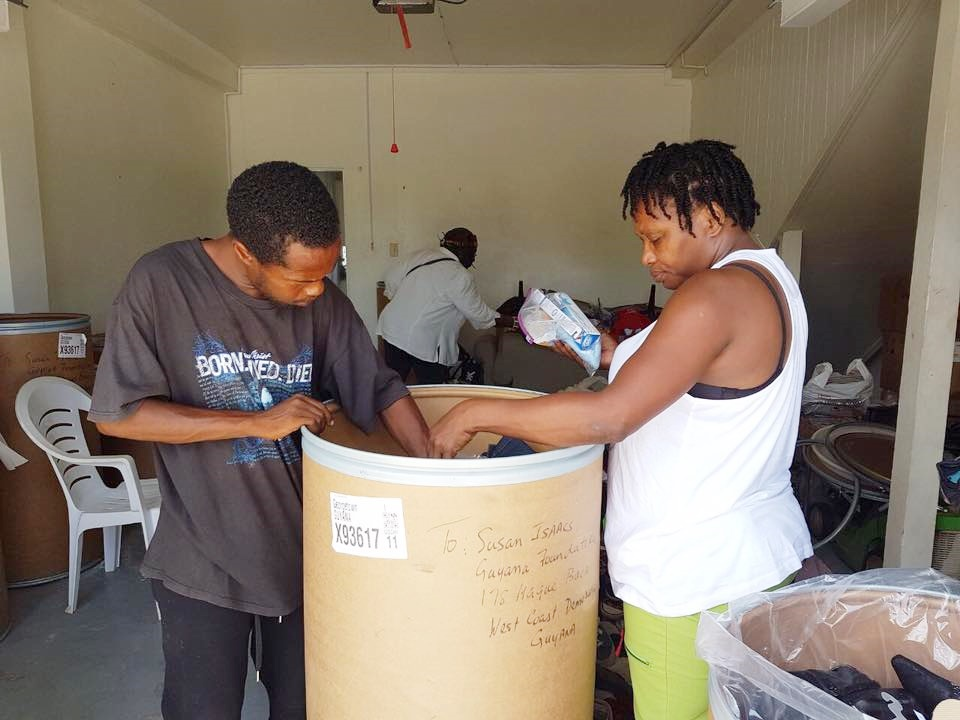 Volunteers helping to sort out the barrels donated by Ms, Fransic Yvonne Jackson.