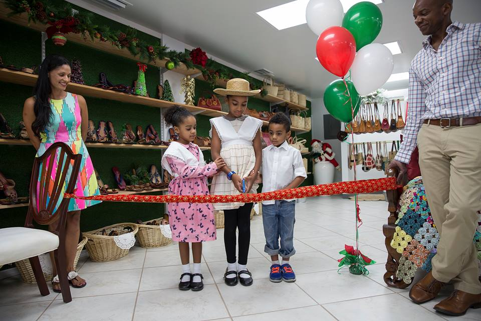 Chloe, Naomi and Asher with their Mom, Joannah and Dad, Peter, cut the ribbon dressed in old style Caymanian costumes.
