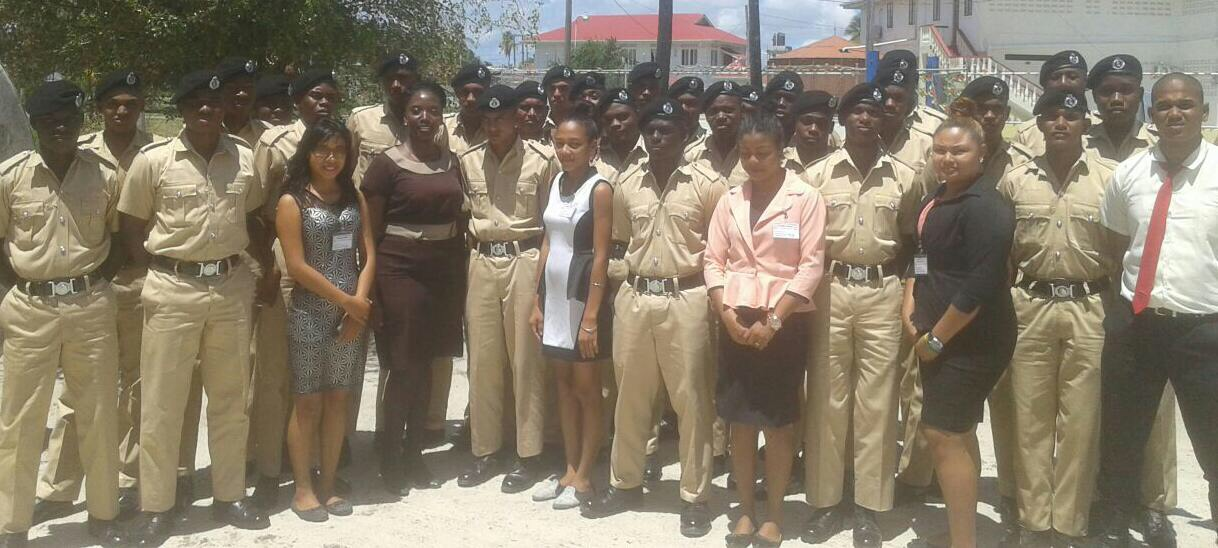 Sunrise Center Manager, Miriam Hinds poses with staff and volunteers of the center as well as police cadets from the training college.