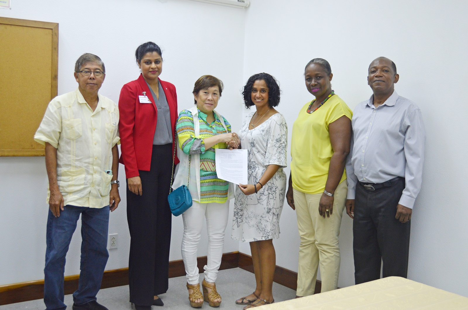 From left are Mr. Stanley Ming, GF Trustee; Ms. Nafeeza Gafoor of Scotiobank; Mrs. Che Jian Ping, GF Trustee; Ms. Sharon Slate, Volunteer; Ms. Vanessa Thompson, Cuso country manager; and Mr. Eric Phillips, GF Trustee.