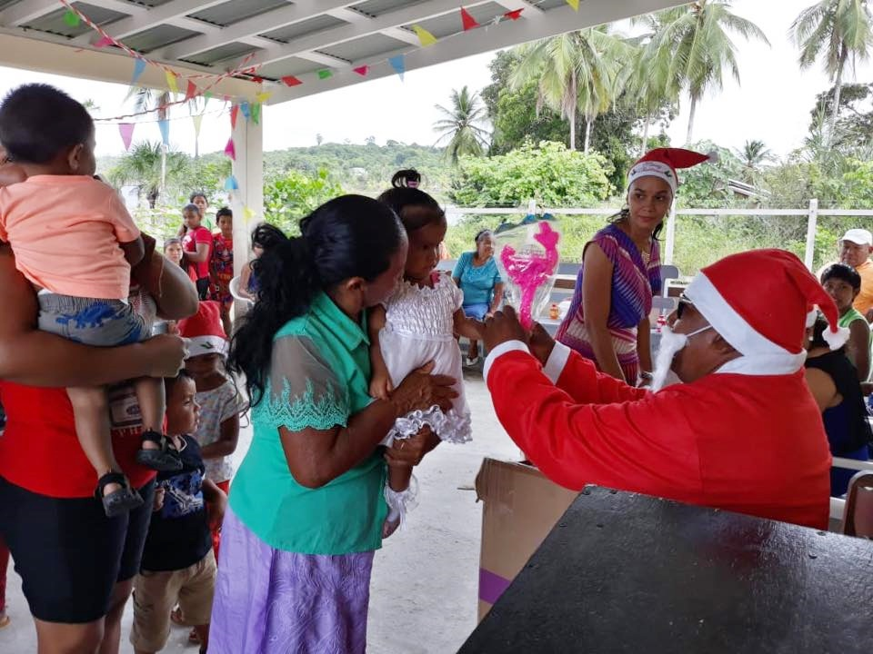 Toshau Slyvian Raphael of Mashabo dressed as Santa distributed gifts to the children of the village.