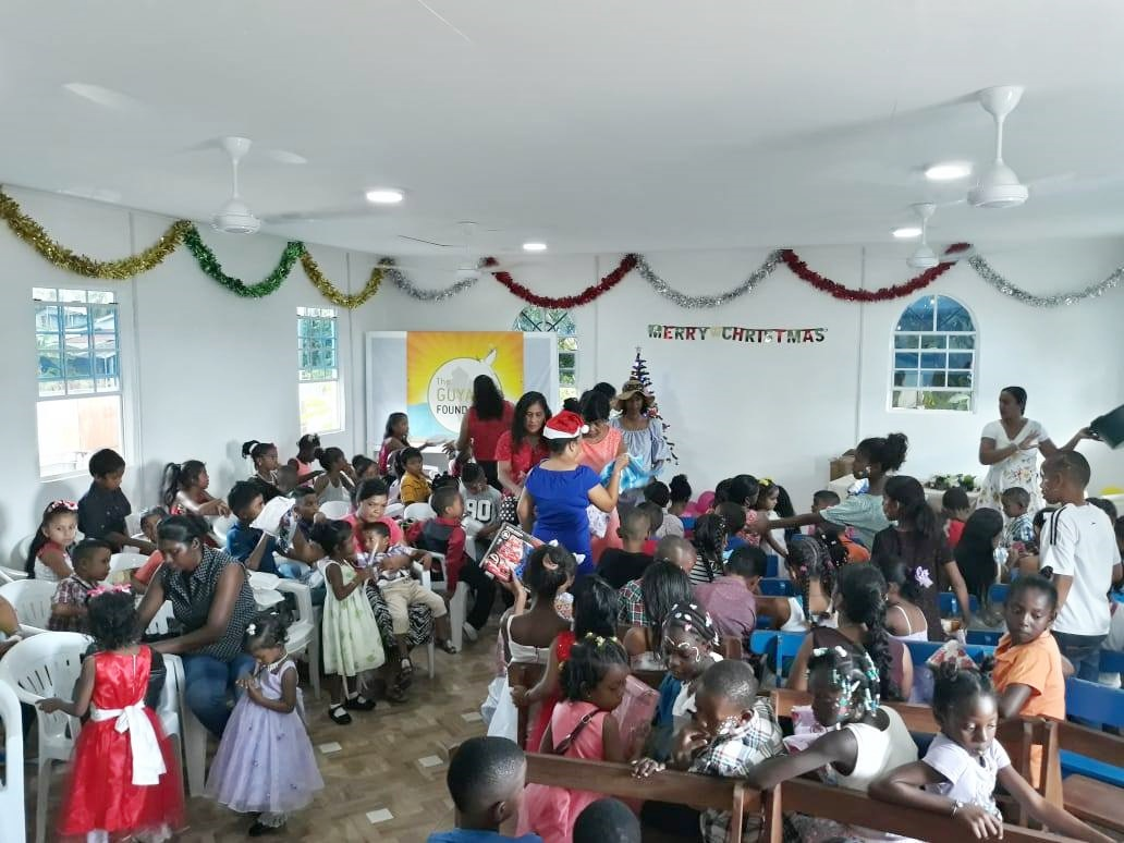 Children of the Essequibo Coast being entertained at the Sunrise Center Christmas party.