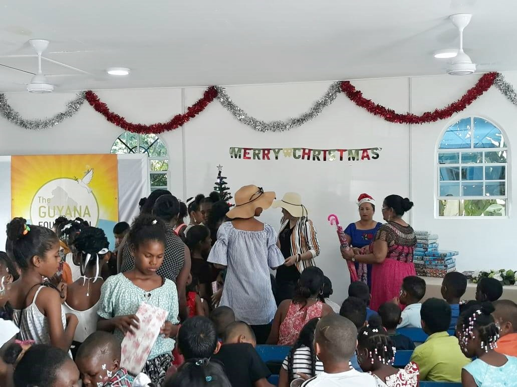 Some of the children with their gifts at the Sunrise Center.