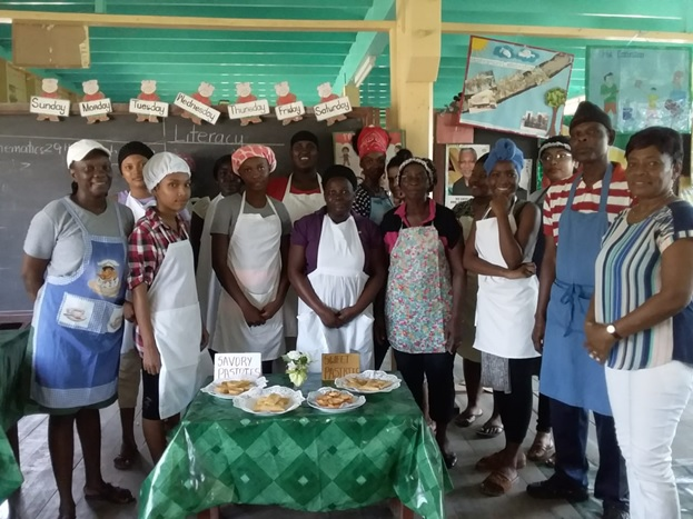 Ms. Glenis Streete (right) and students of the Catering class at Wakenaam.