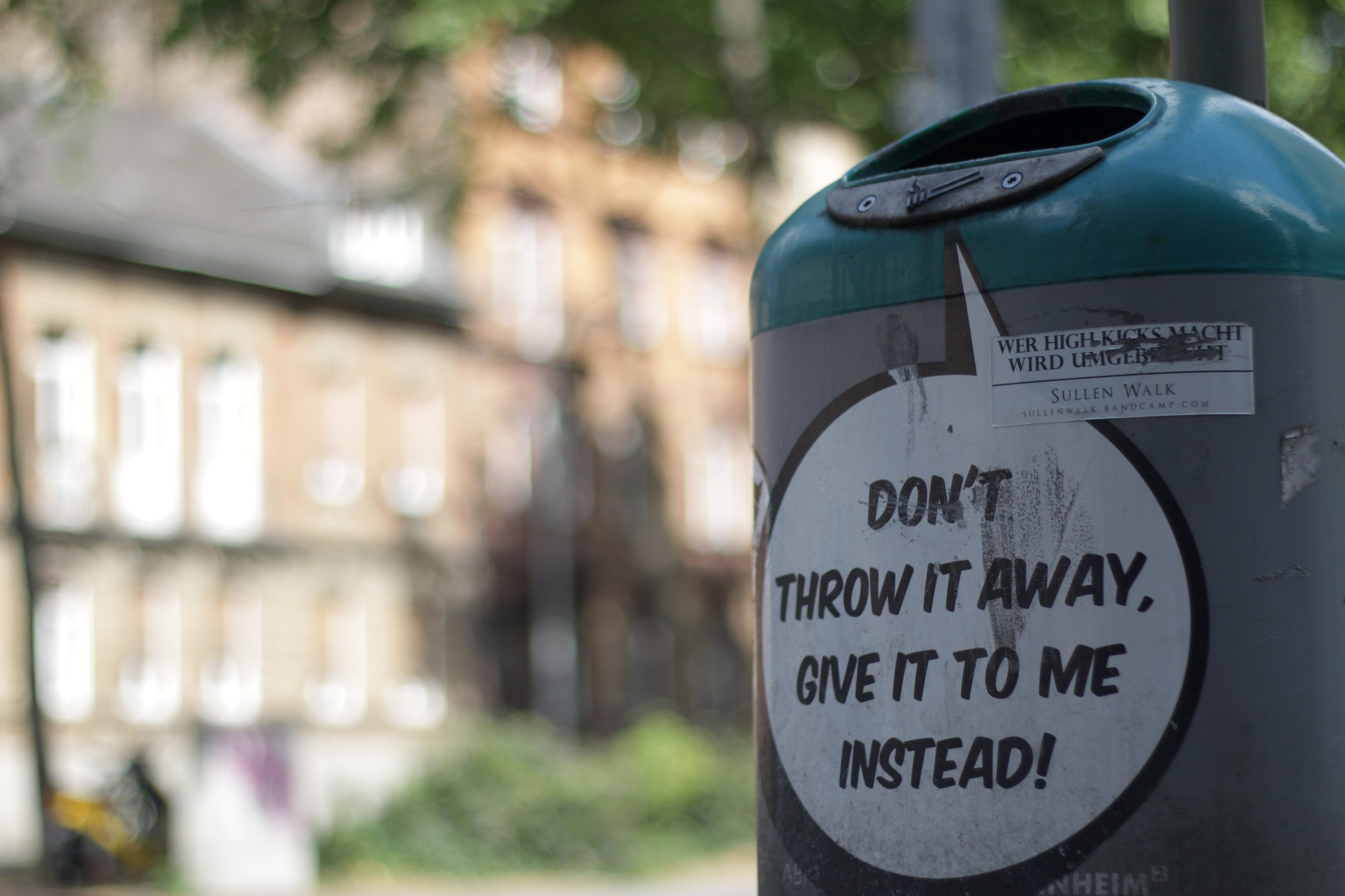 Garbage cans scattered around the city in multiple languages, including English