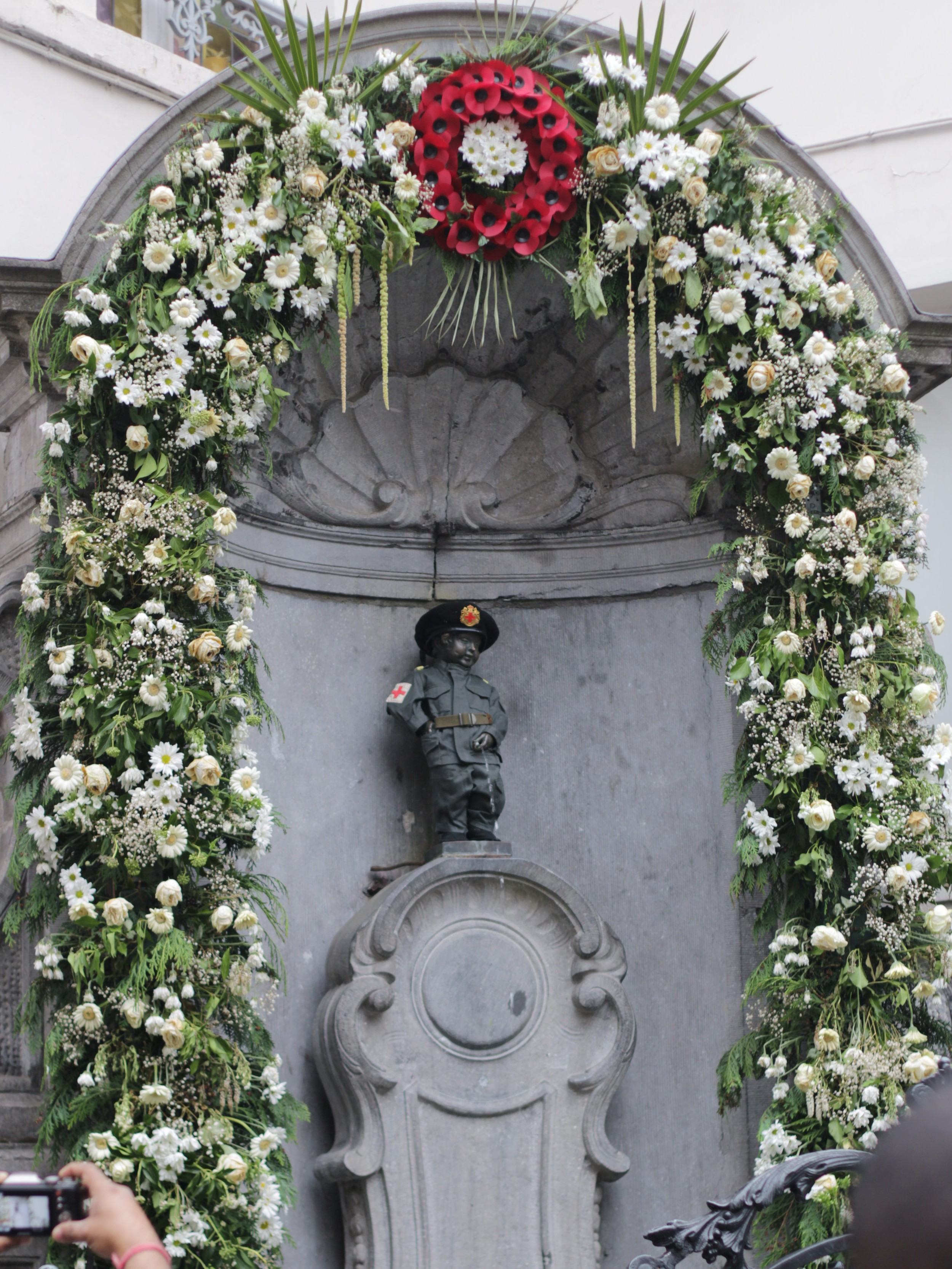 Manneken Pis dressed as a soldier to mark the 100 year anniversary of the start of WW I