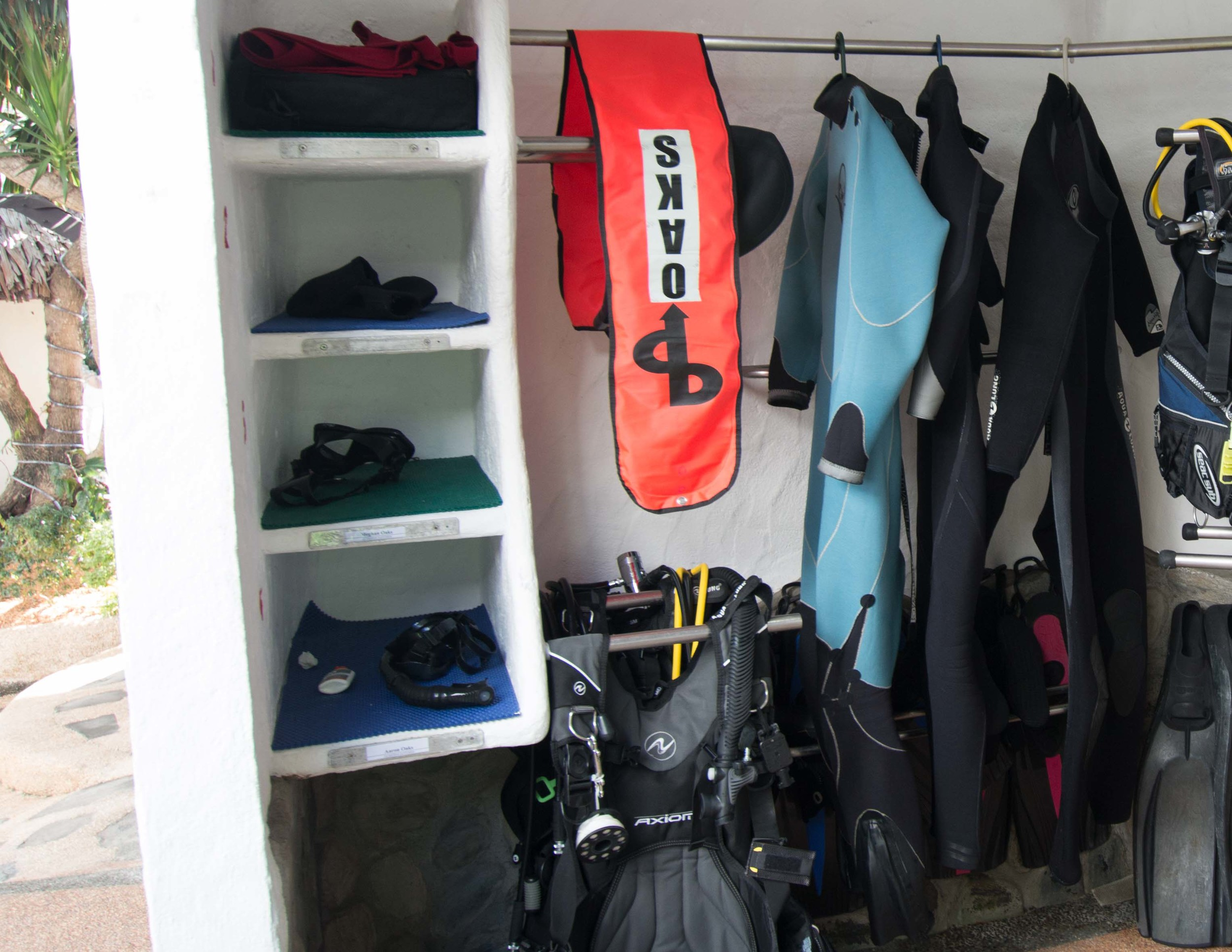 Each diver gets one of the cubbies shown here.  BC and regulator are hung on the bars.  Hangers and spots are provided to hang your wetsuit up too.