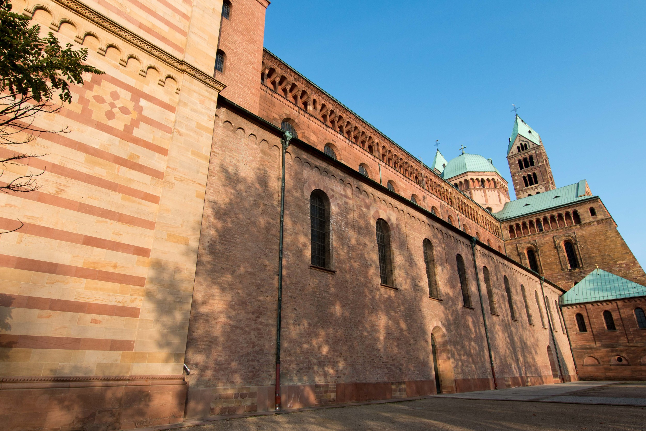 The right side of the Speyer Cathedral. The bottom row of windows dates from the 11th century. The upper widows are from the restoration in the 18th century and the front of the building (striped portion), is from the 19th century.