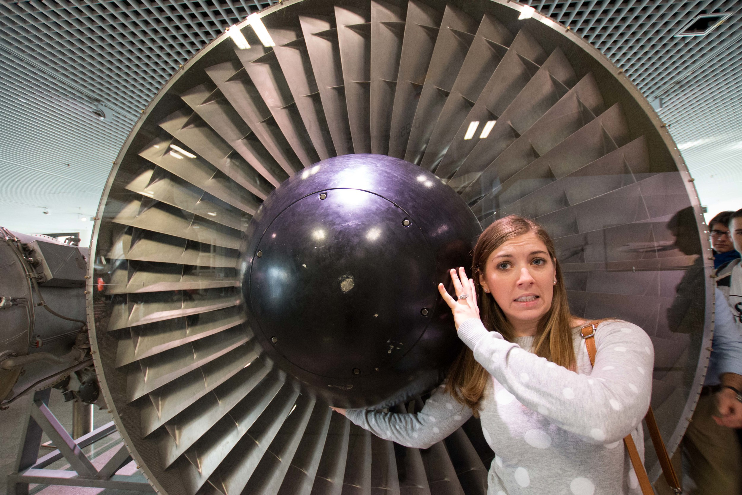 Meghan holding up a plane engine