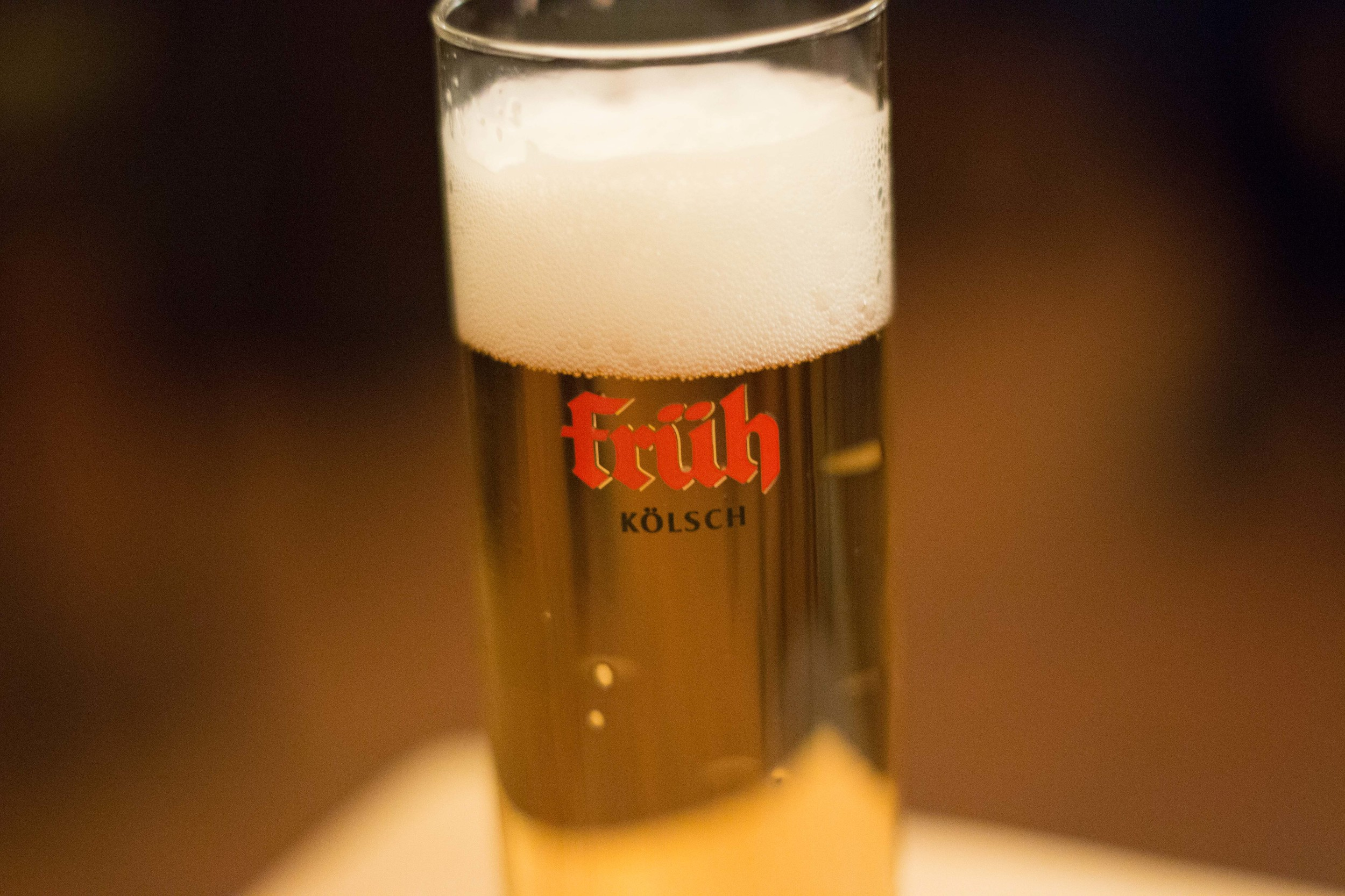A Kölsch from Früh brewery. This beer is always,always, served in a tall, cylindrical glass. Usually in 0.2L increments, but sometimes in 0.4L.