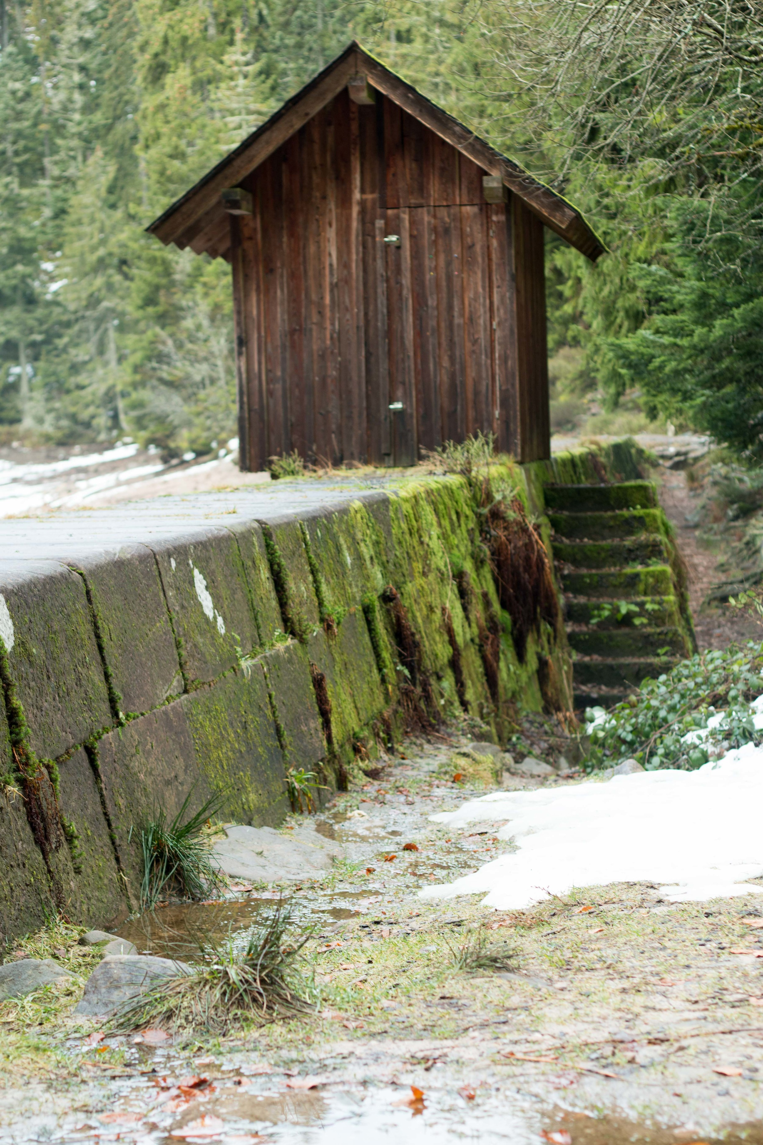 Shack guarding the opening in the dam to let water flow from the lake into a river