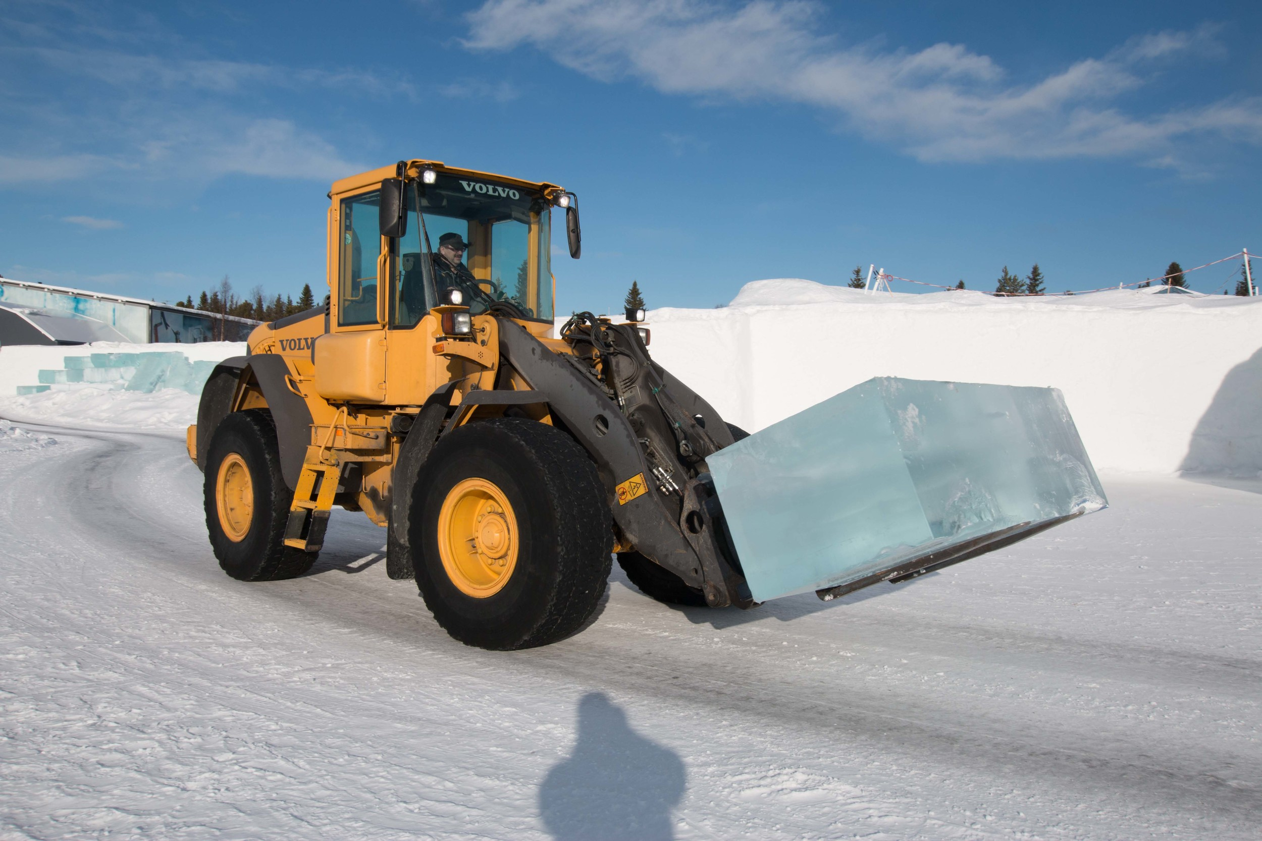 Moving one of the blocks of ice for next year's hotel