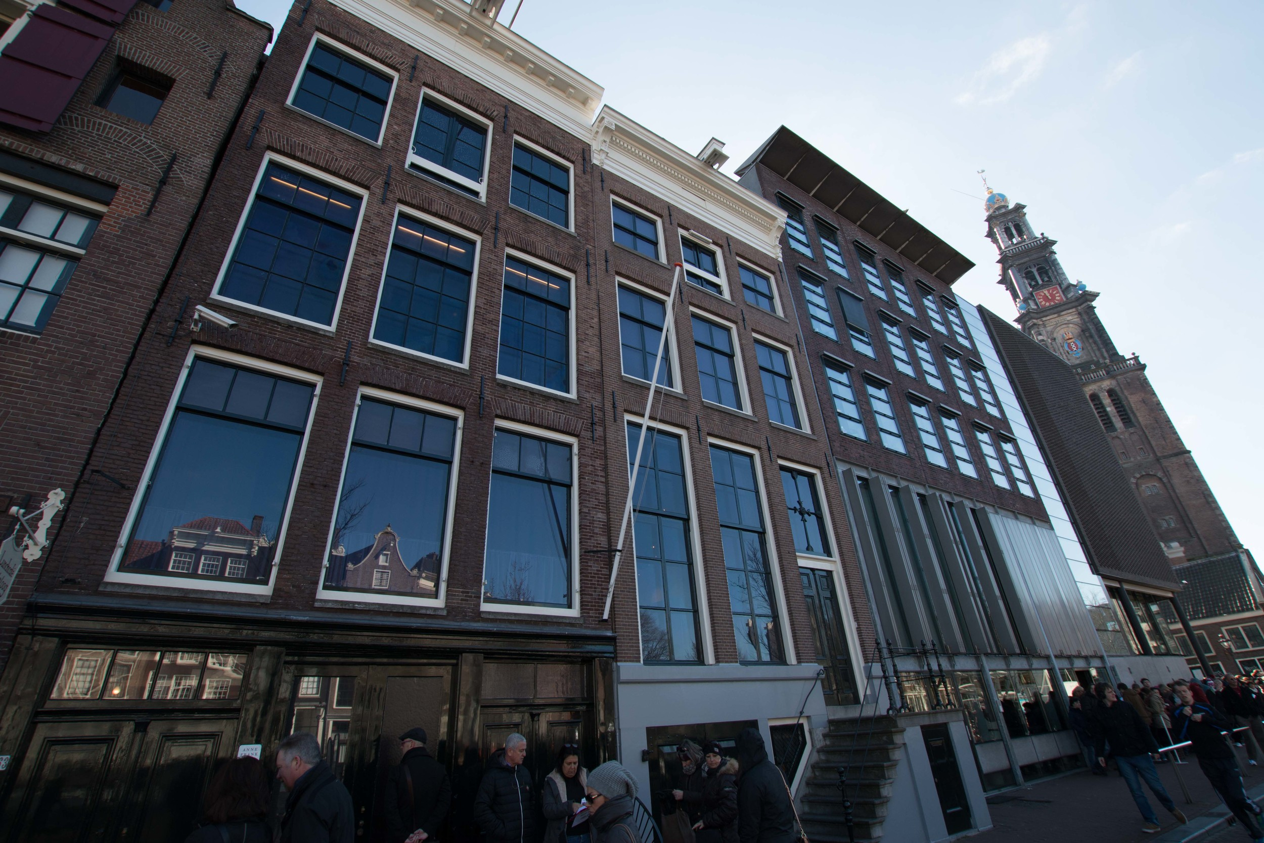 The outside of the Anne frank House. It is the one On the left.