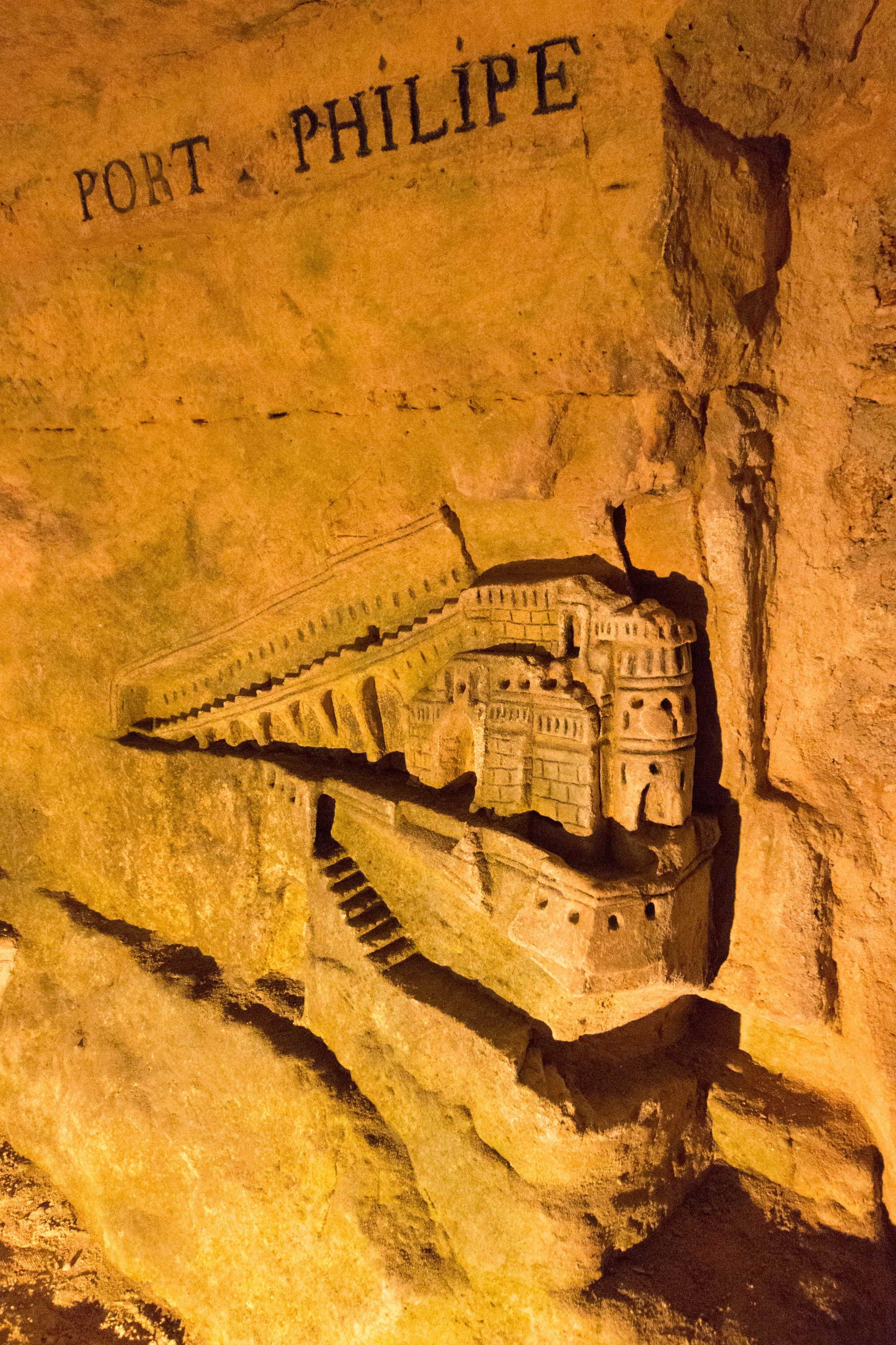 Intricate carving of Port Philipe in the tunnels