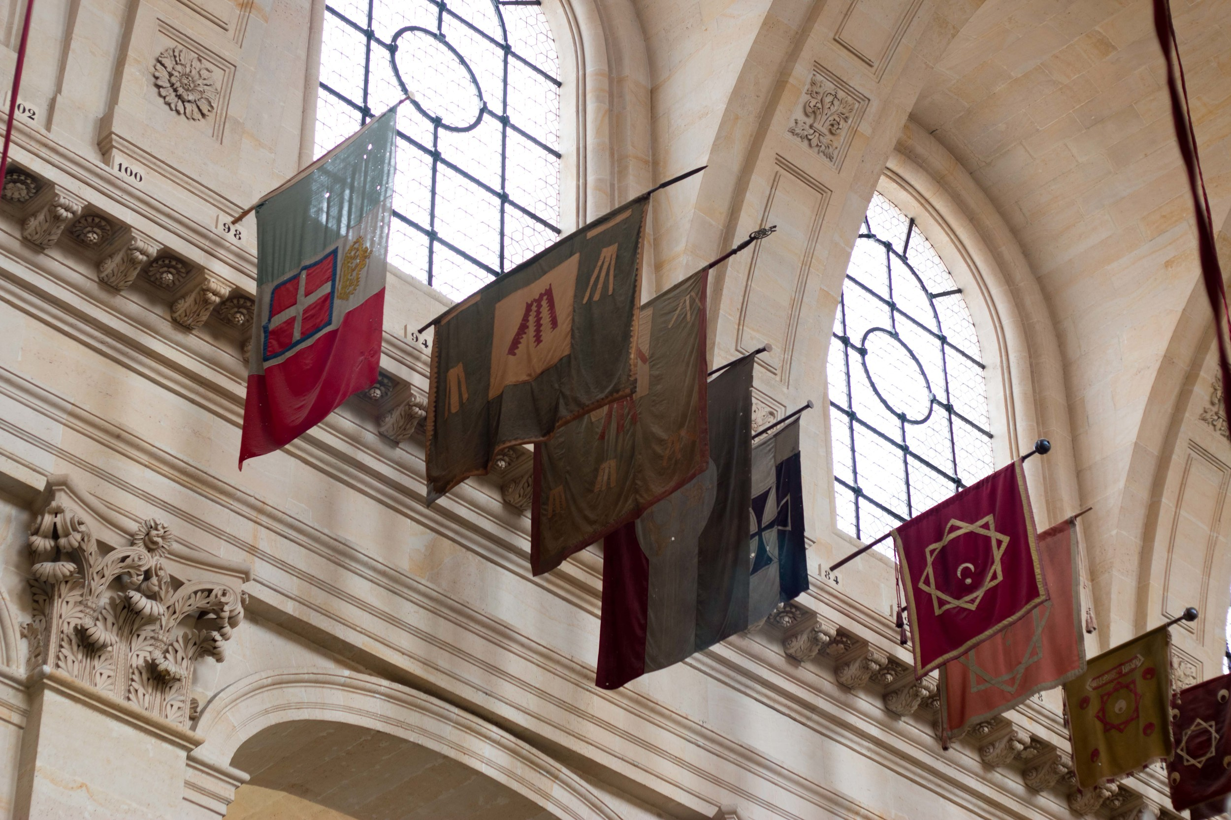 Various flags hanging in the church