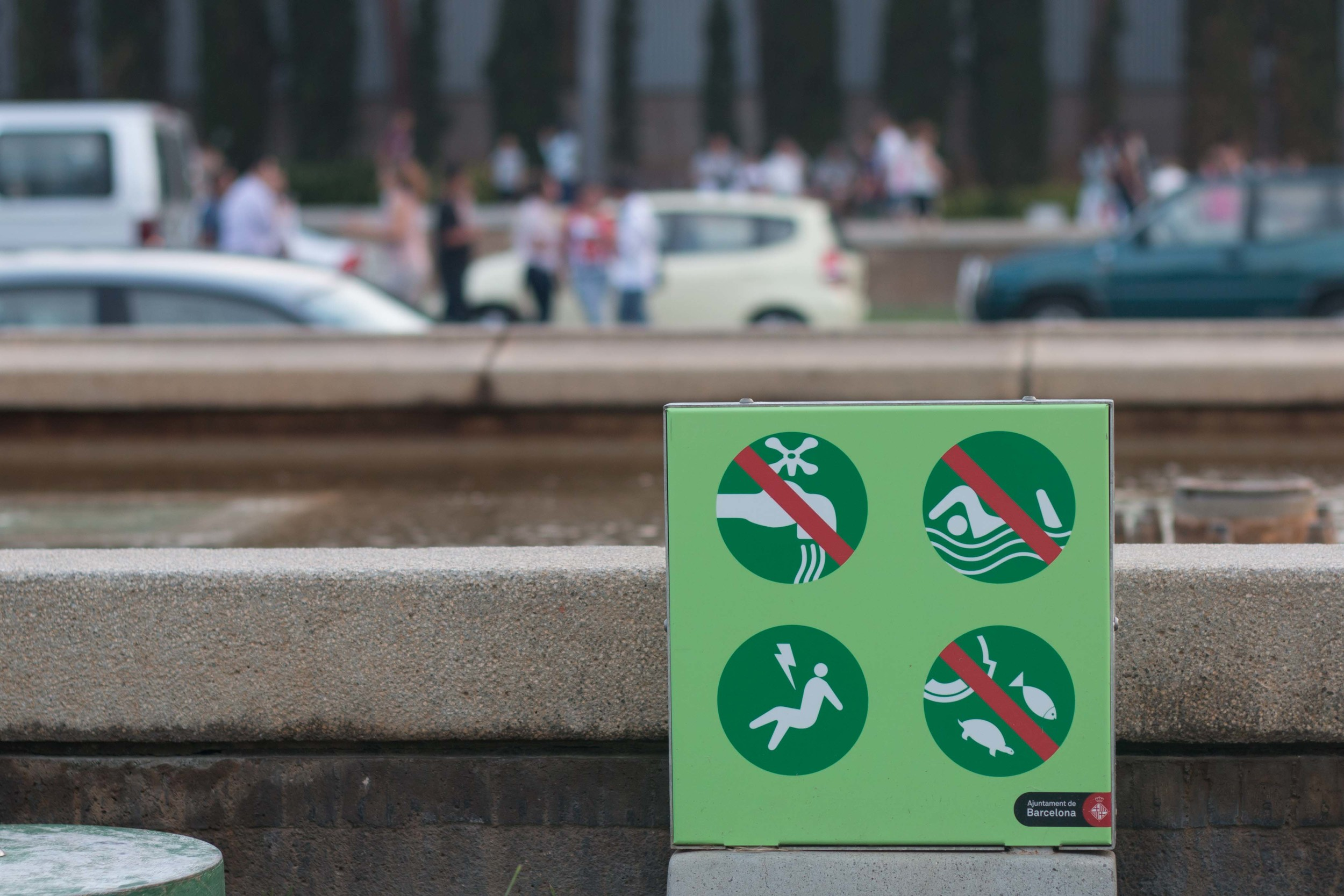 Warnings on the fountains flanking the boulevard leading to the Magic Fountain of Montjuic - no adding water, no swimming, no disposal of fish, and there is a risk of being struck by lightning.