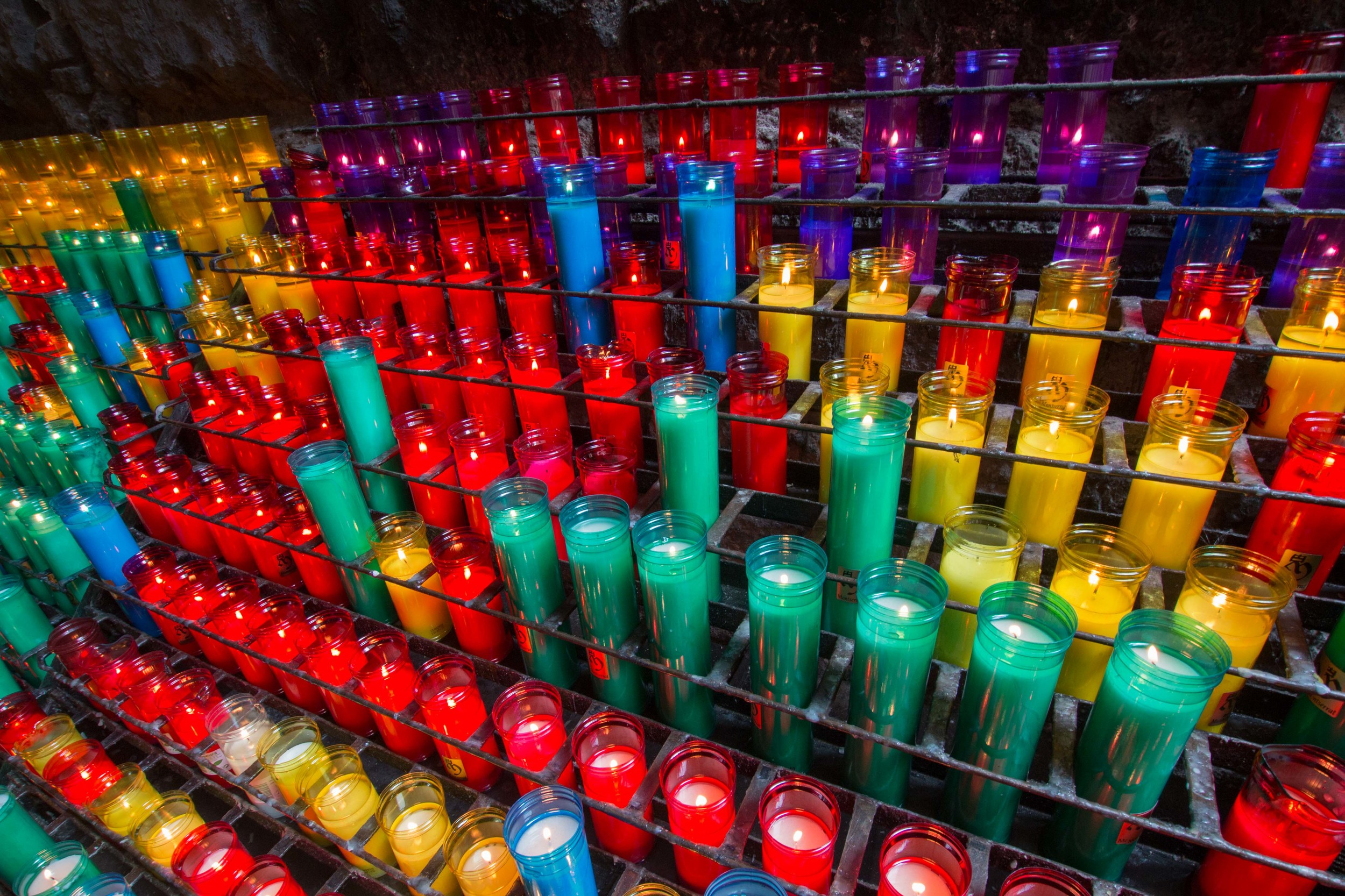 The colorful candles lit by visitors along the Ave Maria Path