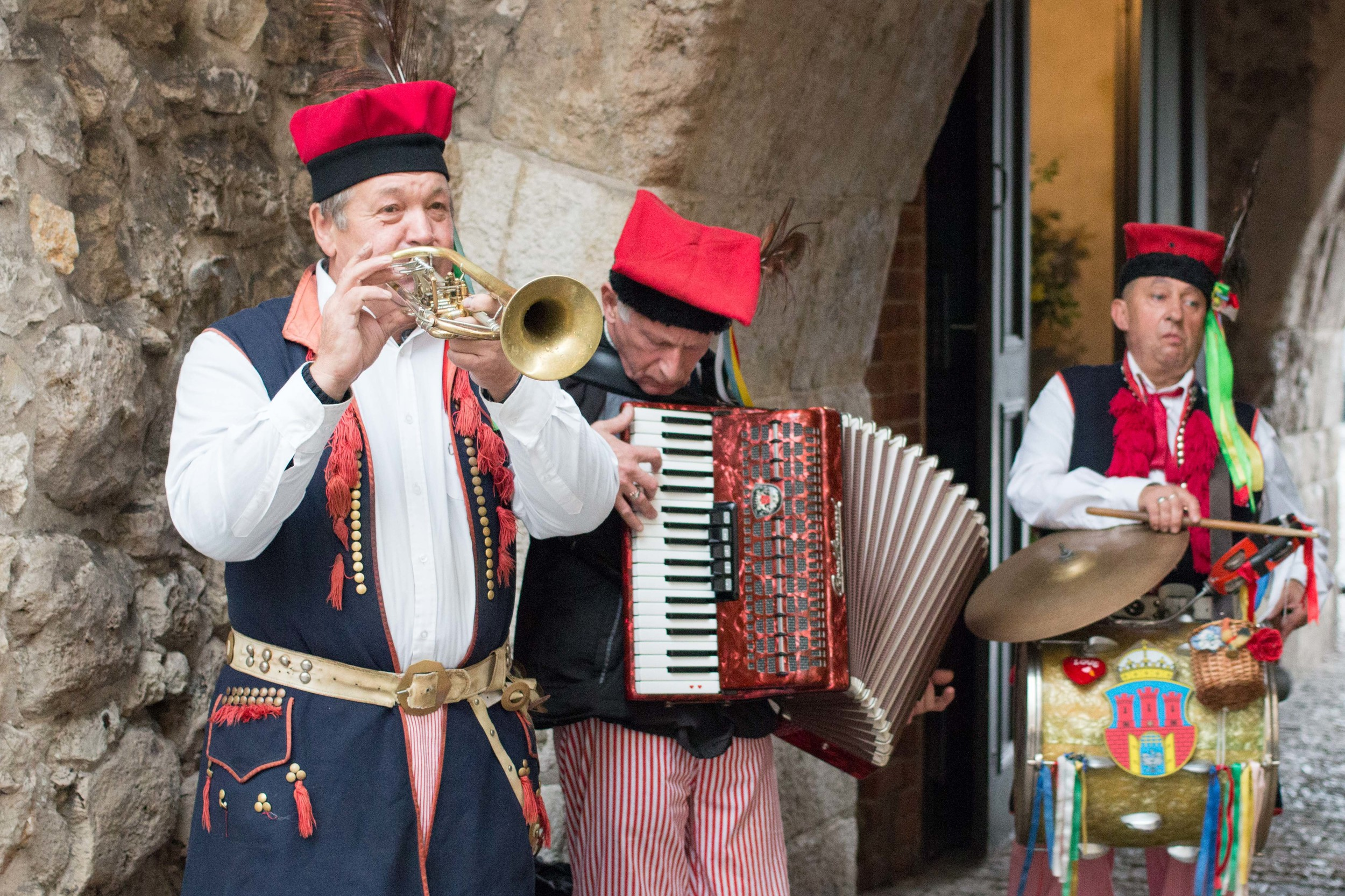 Old men dressed in traditional polish costumes that played music each day at one of the city gates
