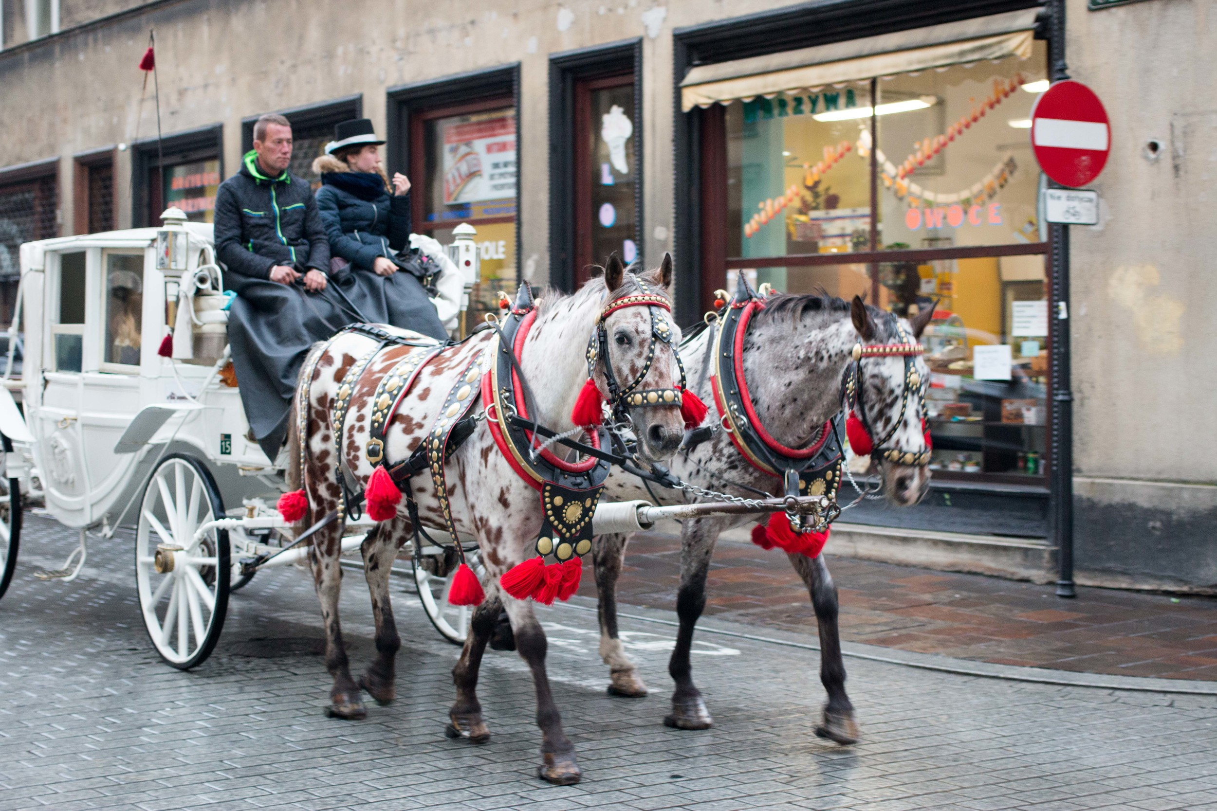 Carriage rides around the old town, drawn by traditionally decorated horses.