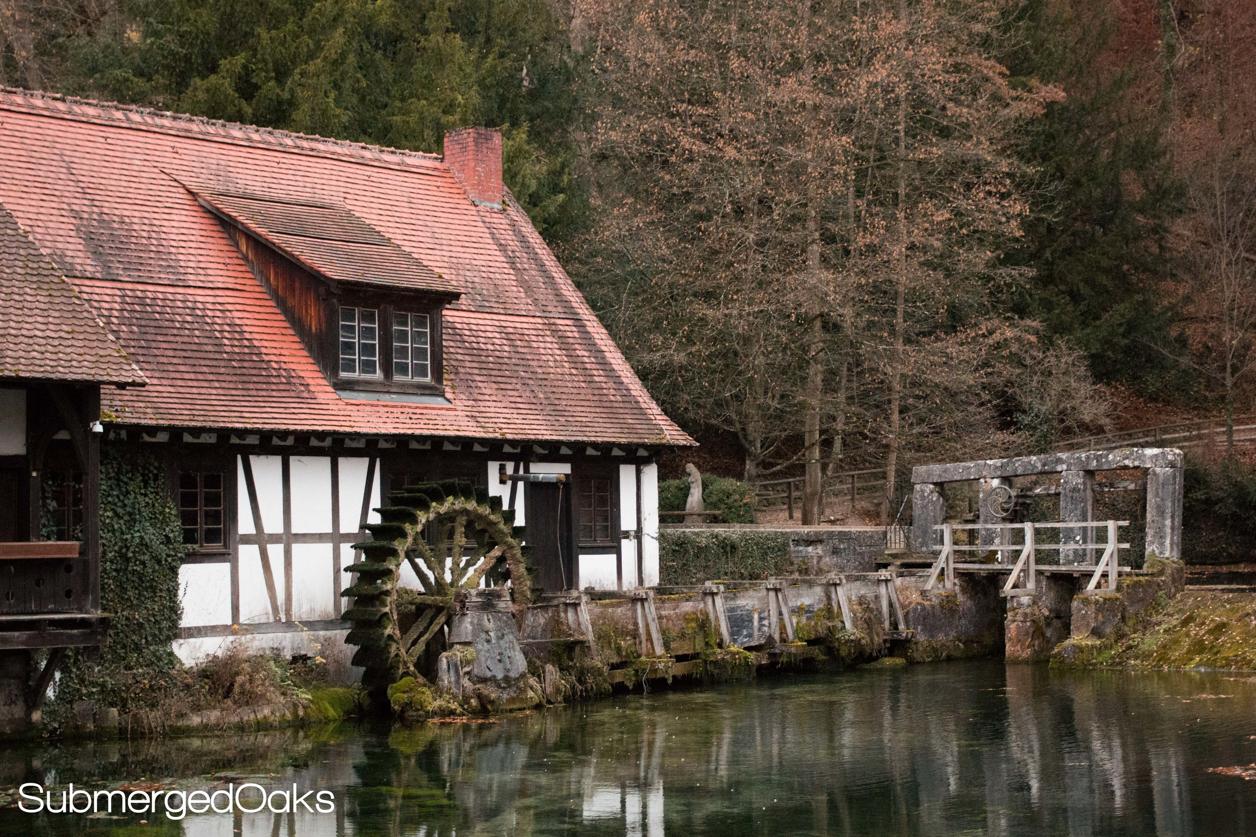 Old saw mill on the banks of the Blautopf spring