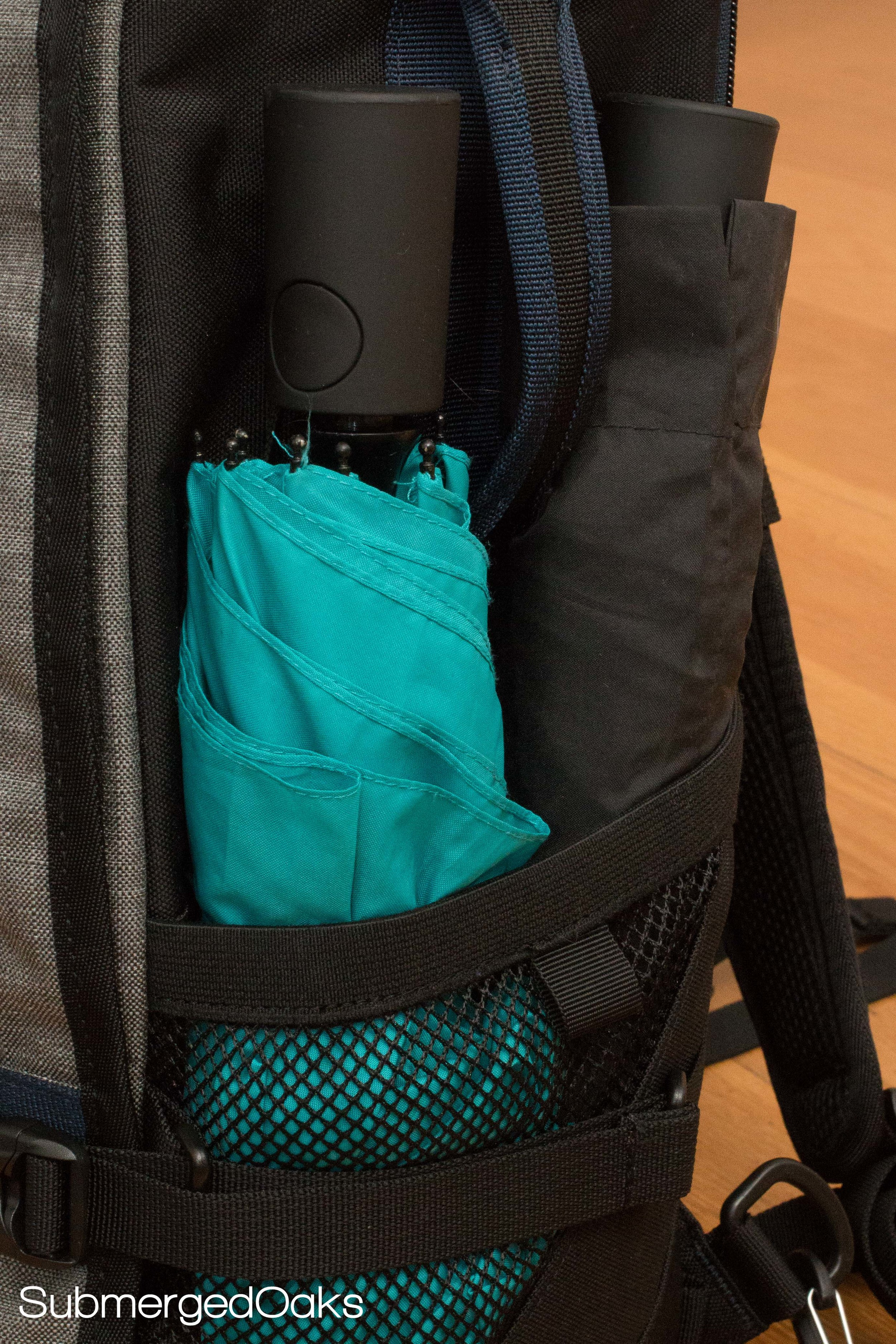 Two umbrellas fit in one of the outer mesh pockets