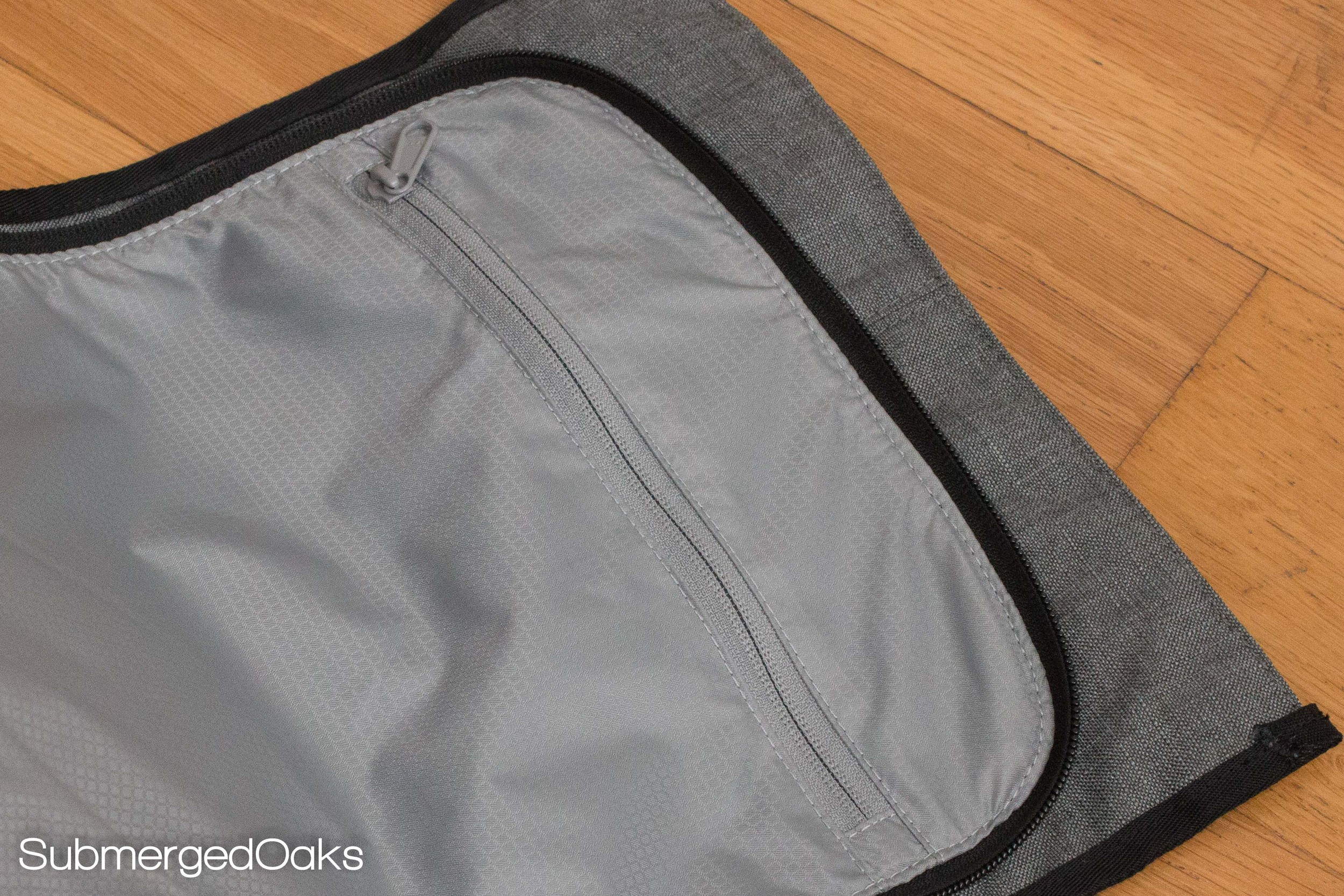 an additional pocket on the opening flap is included for separation of dirty clothes, toiletries, etc.