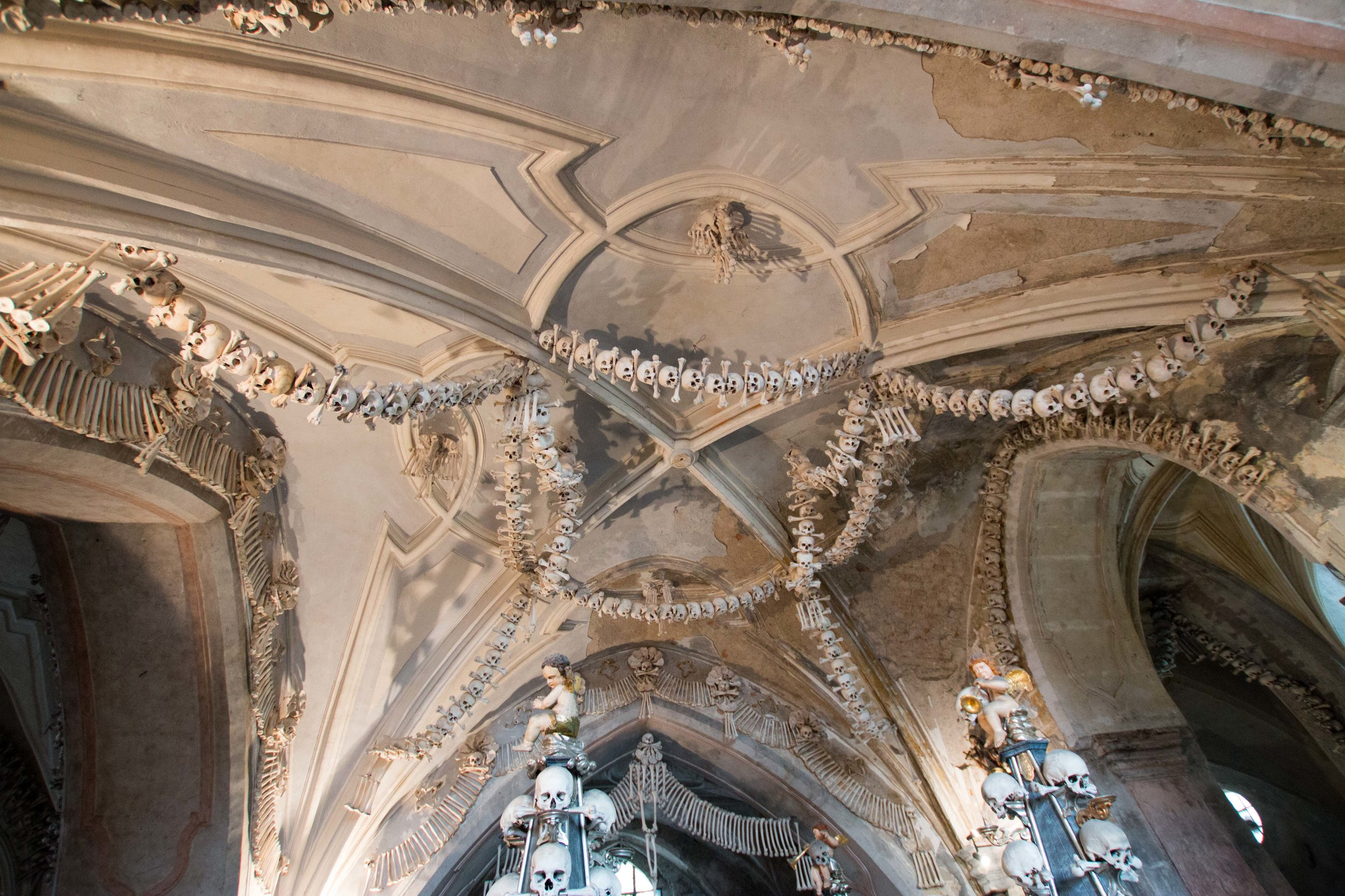 garlands made from skulls hang from the cieling