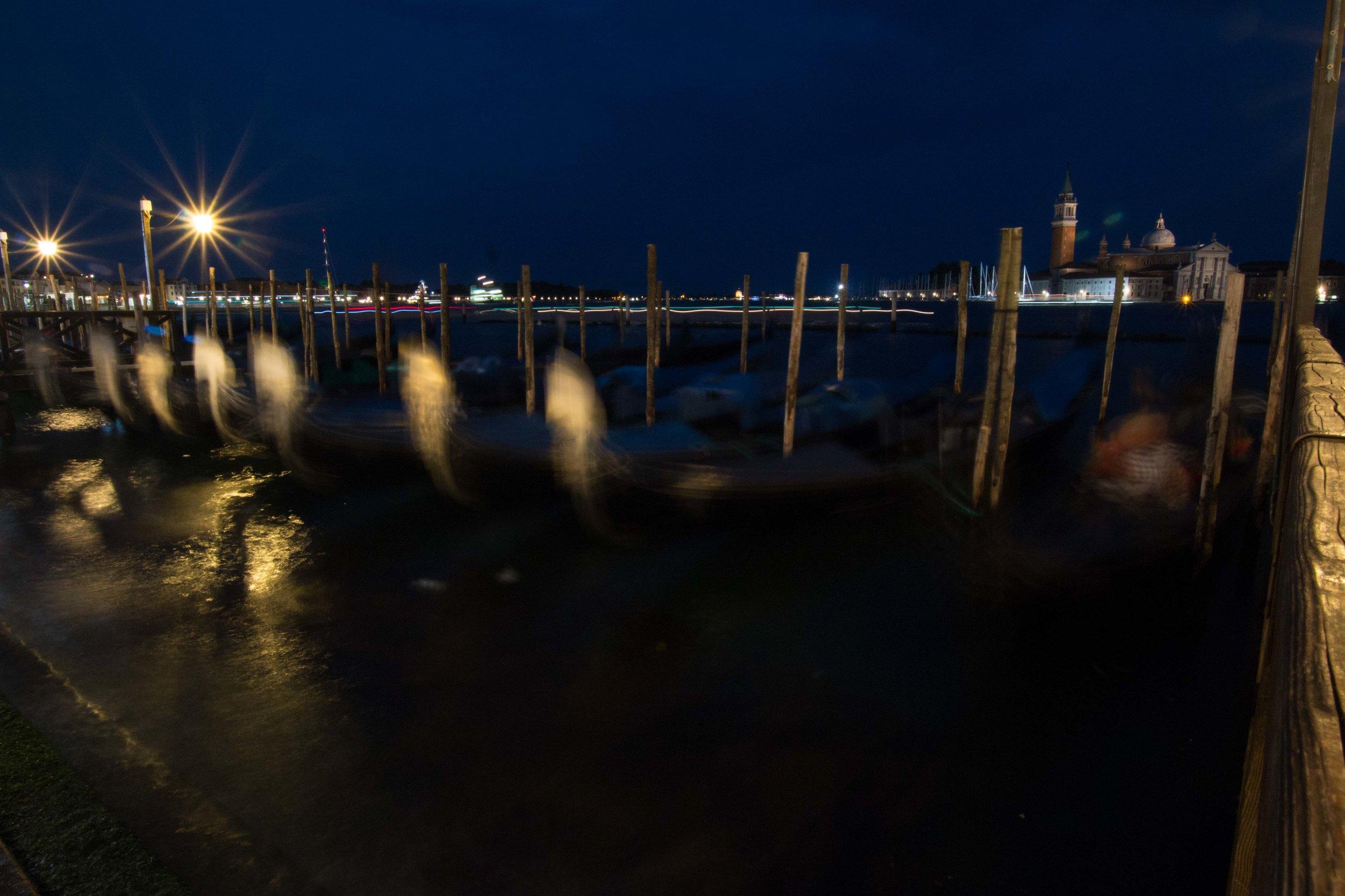 Gondolas bobbing at night