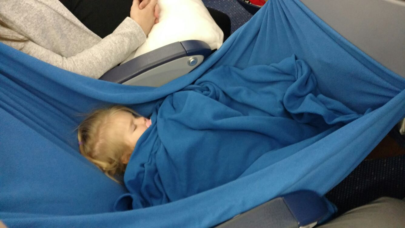 Makeshift sleep hammock out of airplane blankets