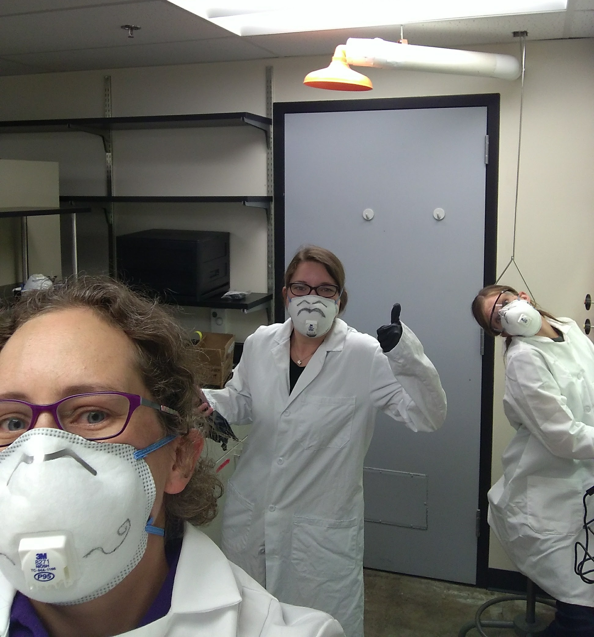 The lab crew during our decomposed human rib dissections. We always wear proper personal protective equipment, including glasses, masks, gloves, and lab coats.