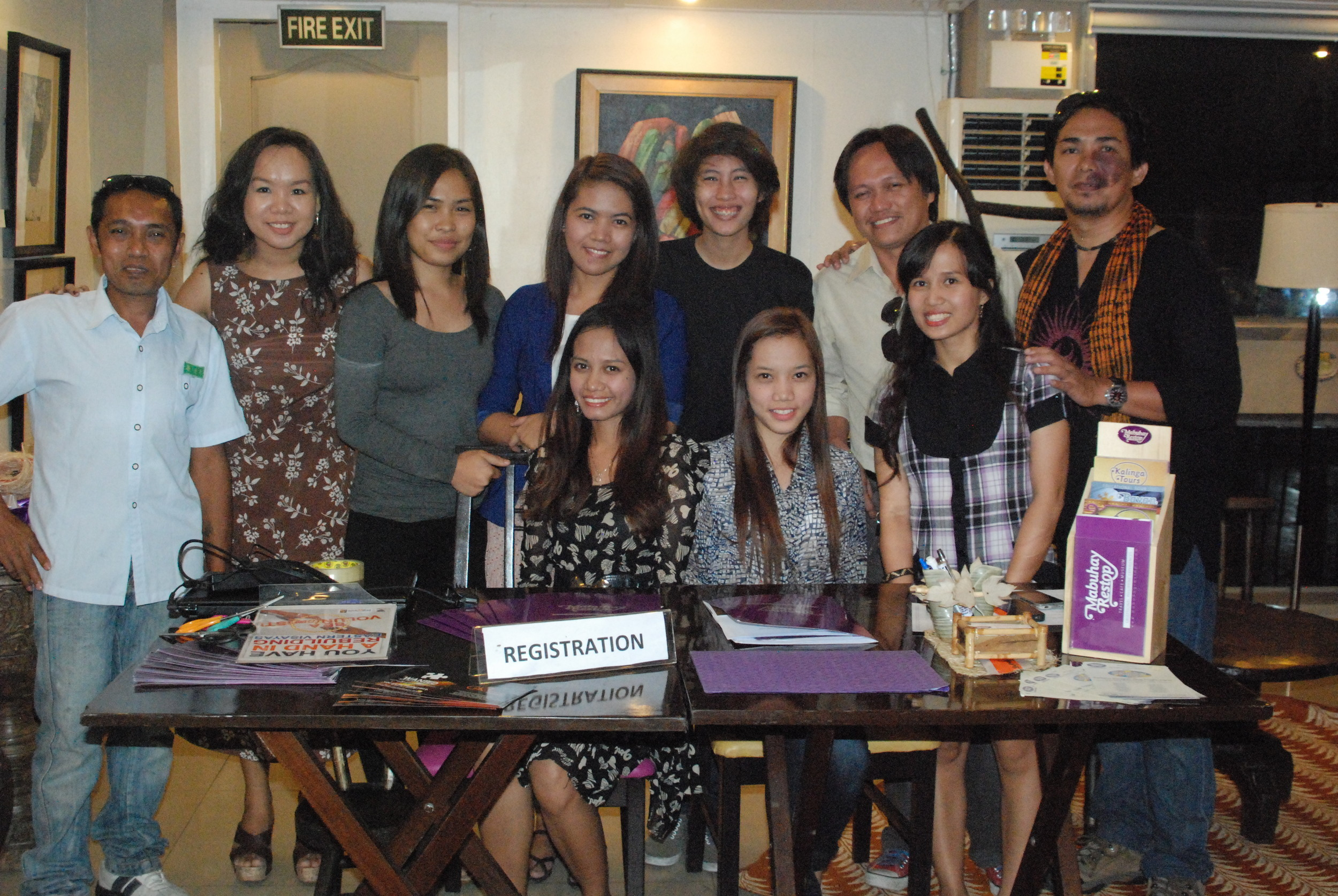 Mabuhay Restop Intern Anne Pagkalinawan poses with co-workers at an event.