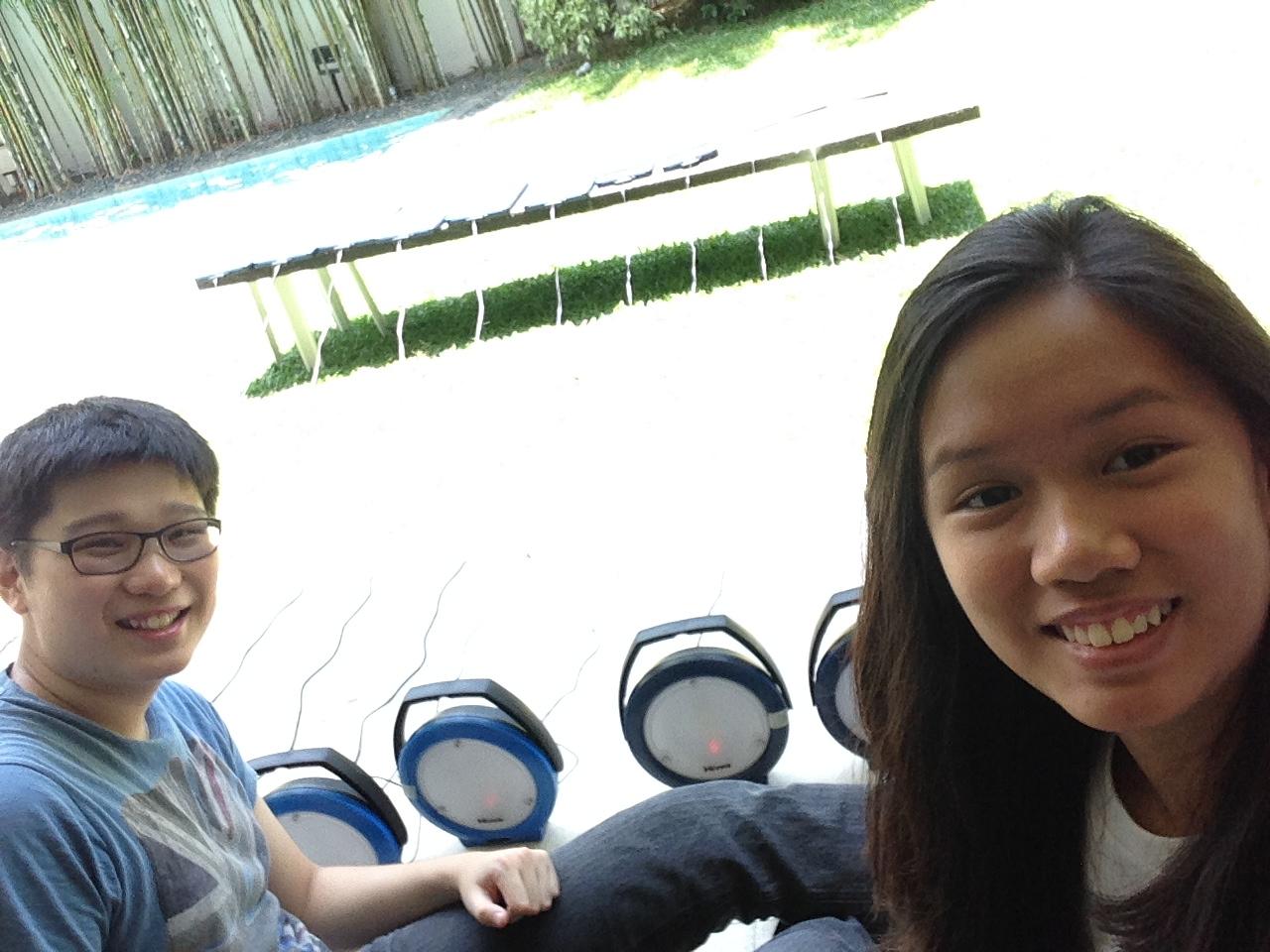 HSSi summer intern Matthew Yap and 2014 mentee Nicole Alberto with HSSi solar powered lights.