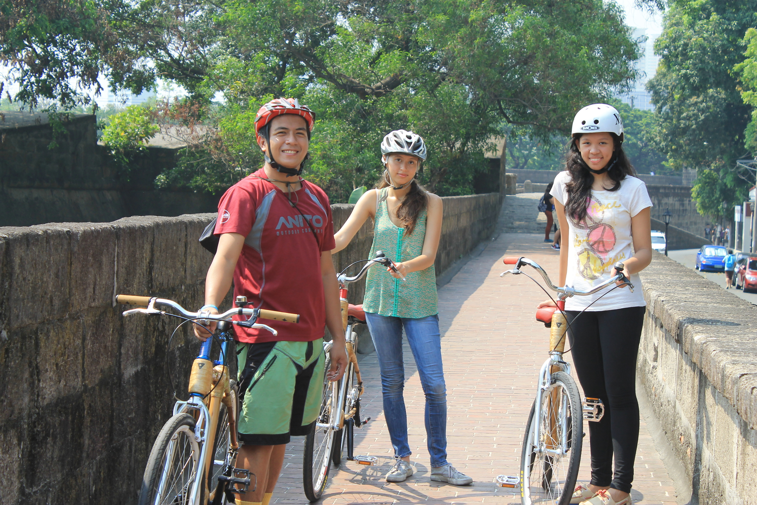Bambike Intern Linet Dumag riding a company bicycles in the park with co-workers.