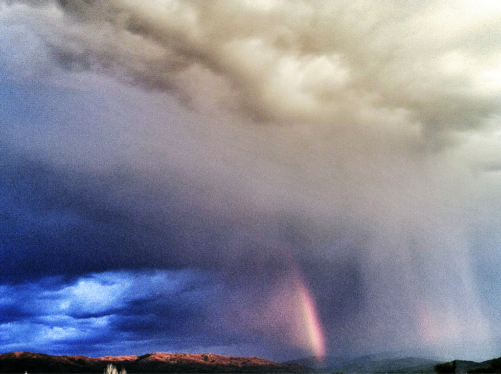 Storm clouds and rainbow gather over Mt. Sopris this evening.
