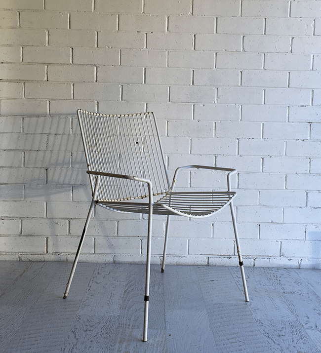 BEFORE 'I found this chair on the side of the road and love the shape. But up close it has surface rust and damaged areas.'