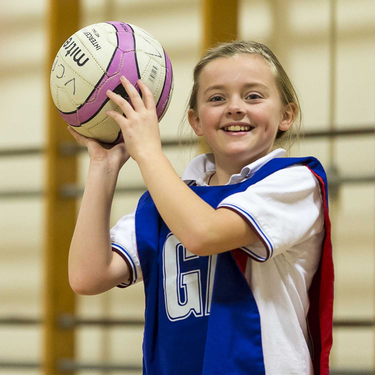 Girl playing Netball