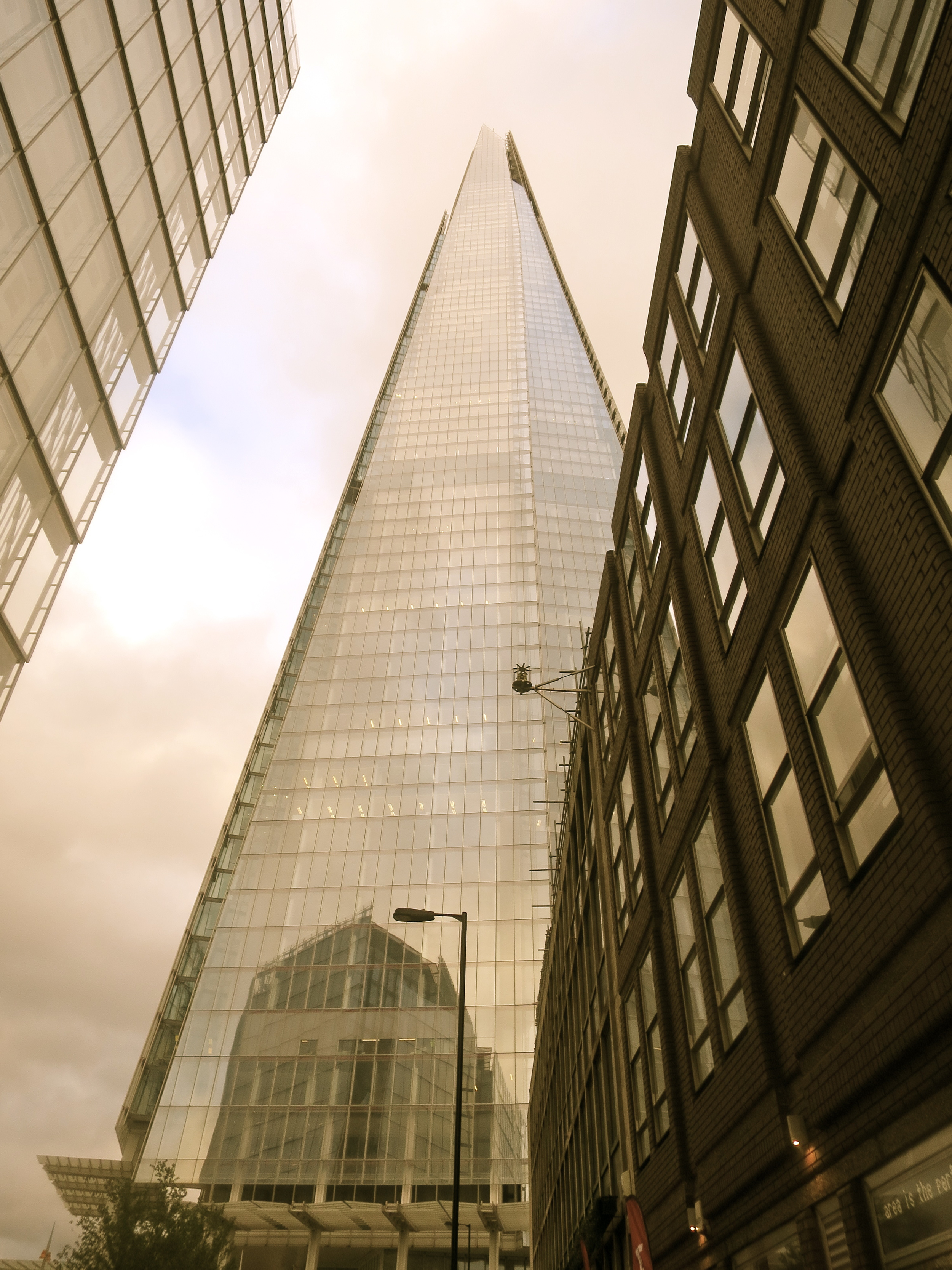 Staring up at the sky via the tallest building in Europe.