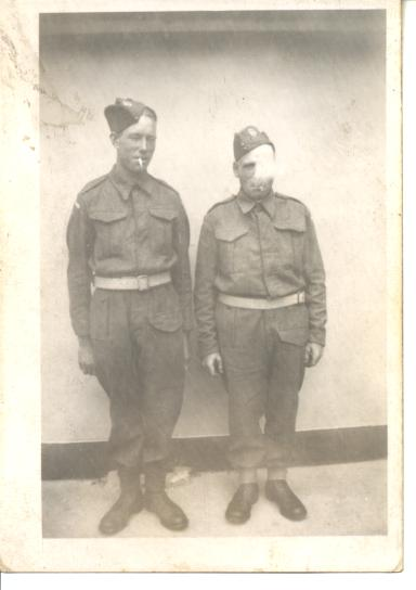 My Grandfather (to the left) and his brother-in-law in their Home Guard uniforms getting up to some cheeky antics!