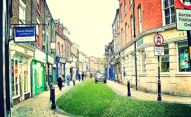 Green grass will flourish.  Controversial plans to rip up the cobbles of Finkle Street took an unexpected turn today when it was announced that the historic Selby street would most likely be turfed.  Unveiling the plans, the project was described as both sustainable and an environmentally friendly alternative to asphalt.  We spoke to shoppers in the town, Victoria Cole of Hambleton stated, ''I think its a great idea it will look pretty and its different, it will definitely stop drivers going down Finkle Street.'' Although Peter Zafon from Barlby stated that, '' I think it will be an expense to maintain who is going to do this work? Selby Council?''  Part of the plans will see a a large quantity of the old old cobbles to be distributed into a scenic rockery which will be created opposite the post office.  Work is due to get underway in May and are expected to be completed in time for the World Cup.  We would like to hear your views on the new proposals