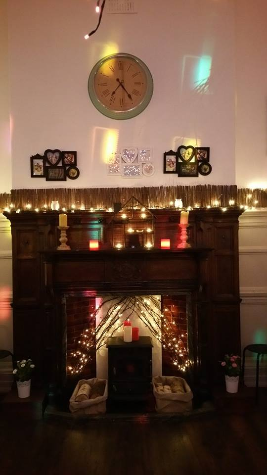 An impressive fireplace which has not changed in over 100 years shows the historical features of the room , if you look closely you can see Selbys emblem of the three swans engraved on the fireplace, the fireplace was a central part of the building when it was a former bank.
