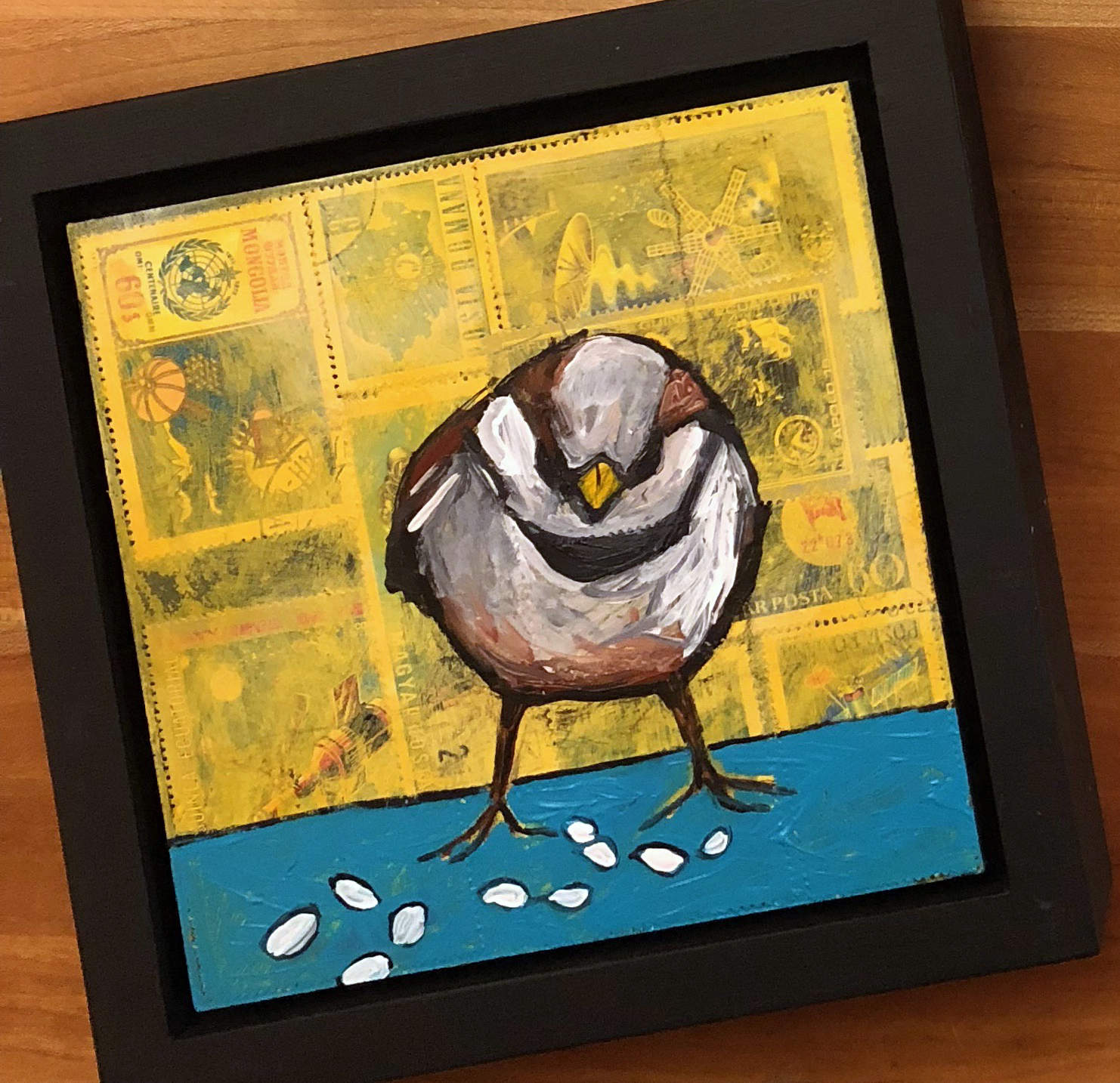 """postal stamps and acrylic on wood, 6.5"""" x 6.5"""" (including frame),  wood frame is 1.5 inches deep and made locally"""