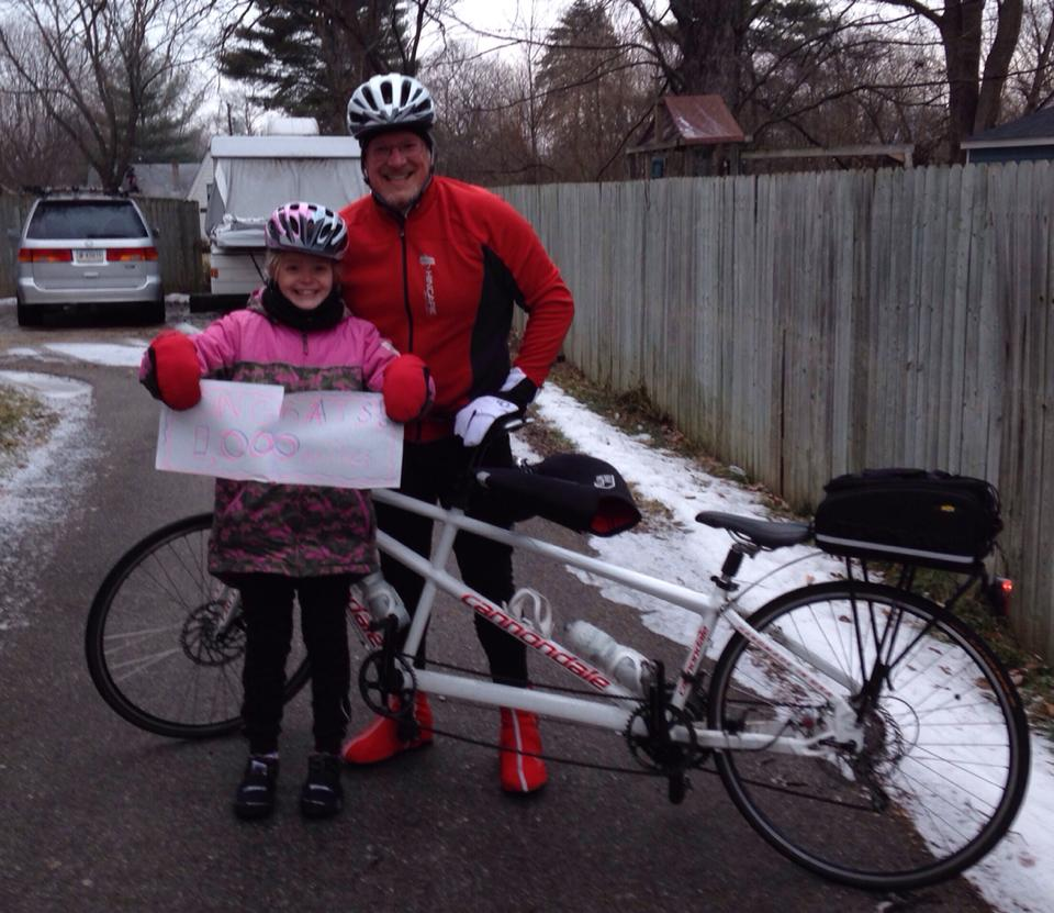 Zoe and Dad in February 2014, celebrating her 1000 miles of cycling while aged 9.