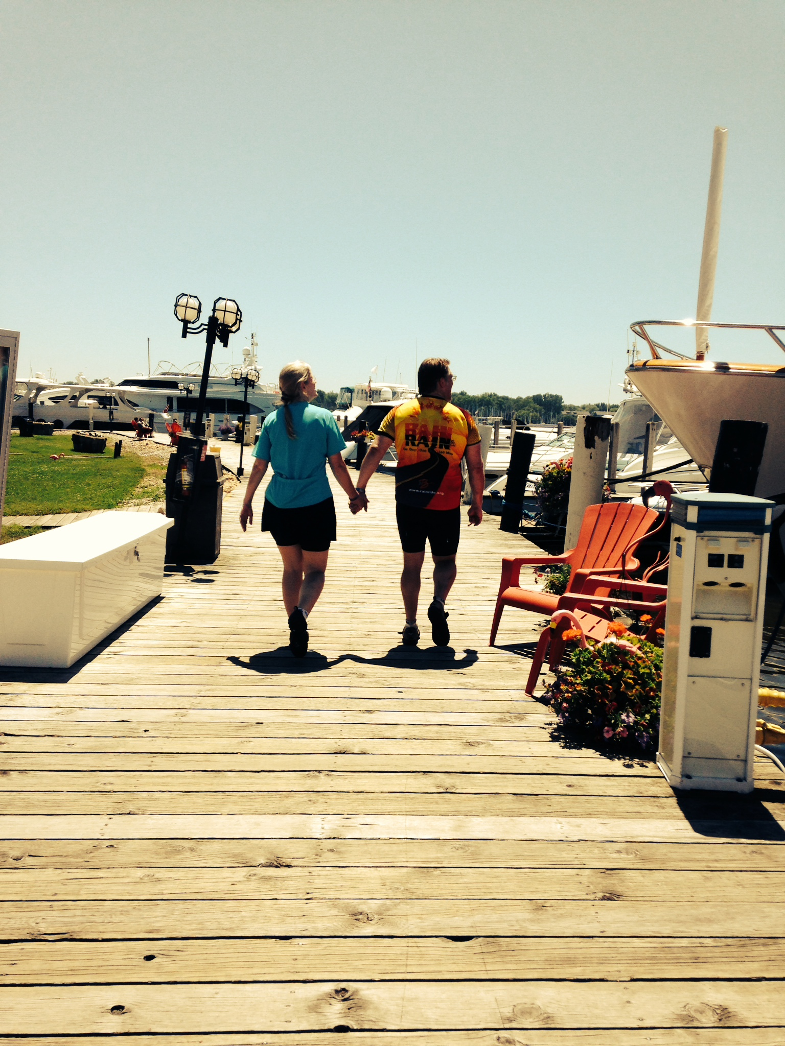 Mom & Dad on the Saugatuck, MI Boardwalk halfway through a 42 mile 25th Anniversary Bike Ride