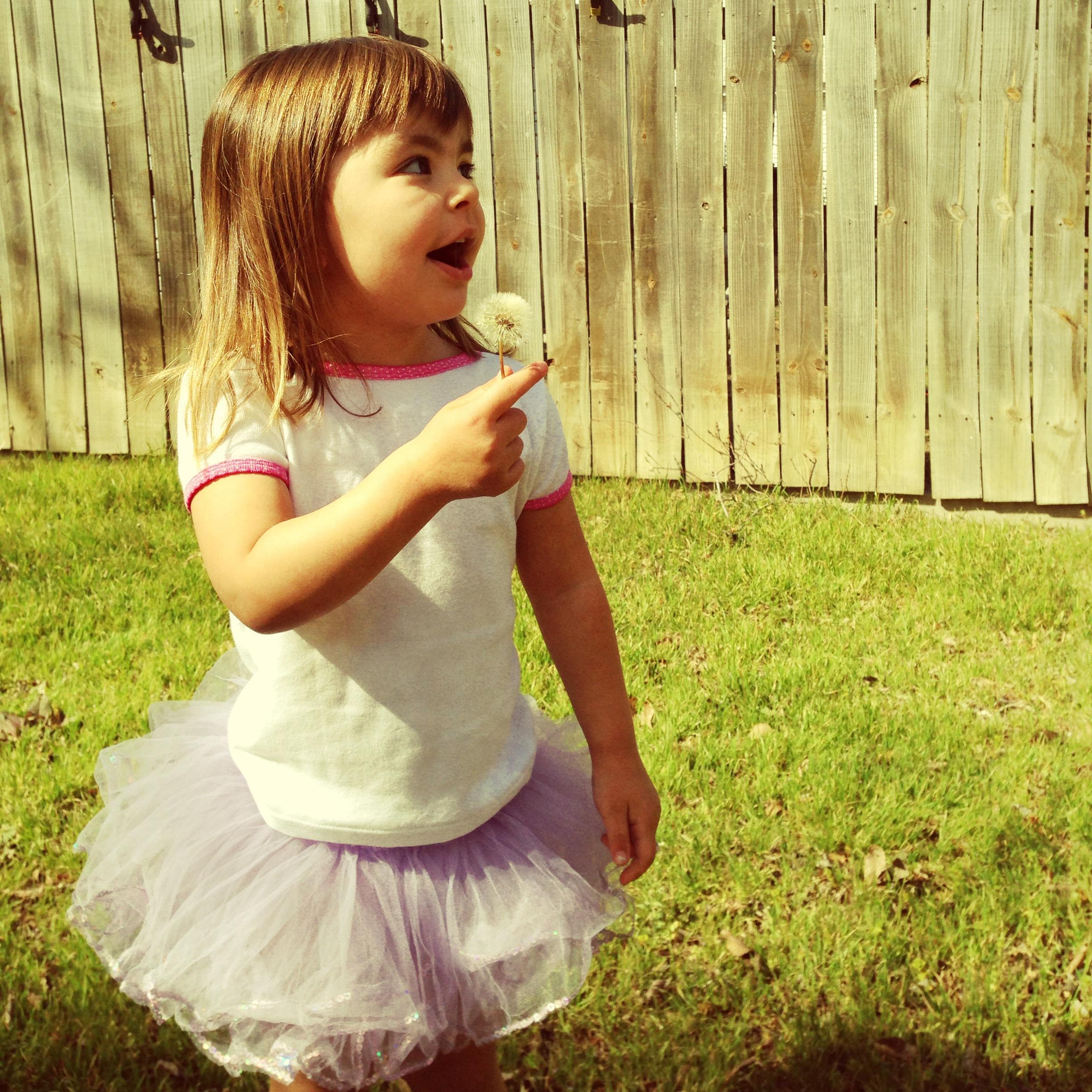 belle blowing dandelion tutu.jpg