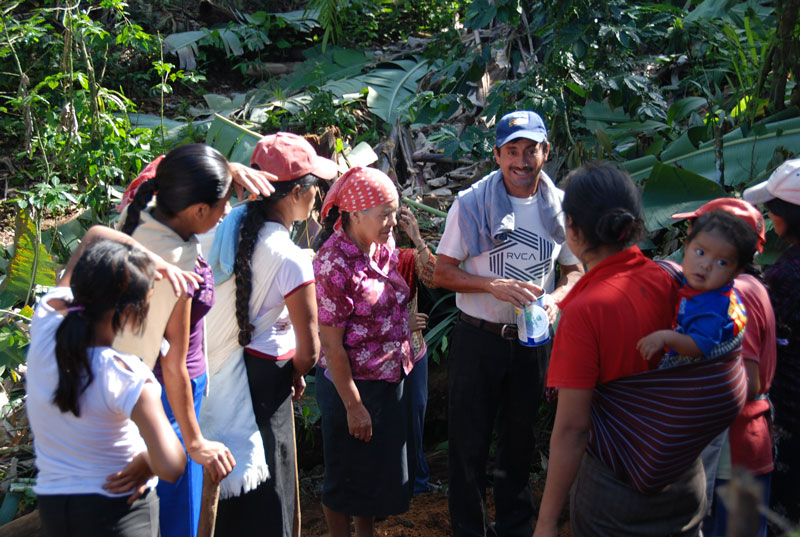 Timoteo (DLG field trainer) giving instructions to the women of La Suiza