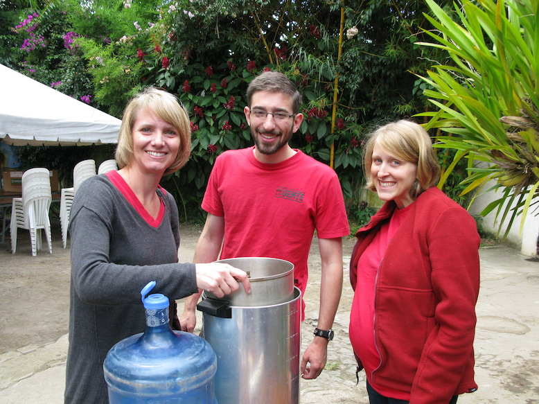 Mindy, Andy and Jane get Saturday's brew of De la Gente coffee ready.