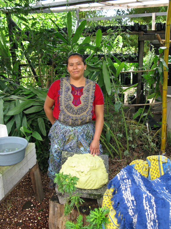 A local woman gets her dough ready for the mountain of tortillas needed for the busy event.